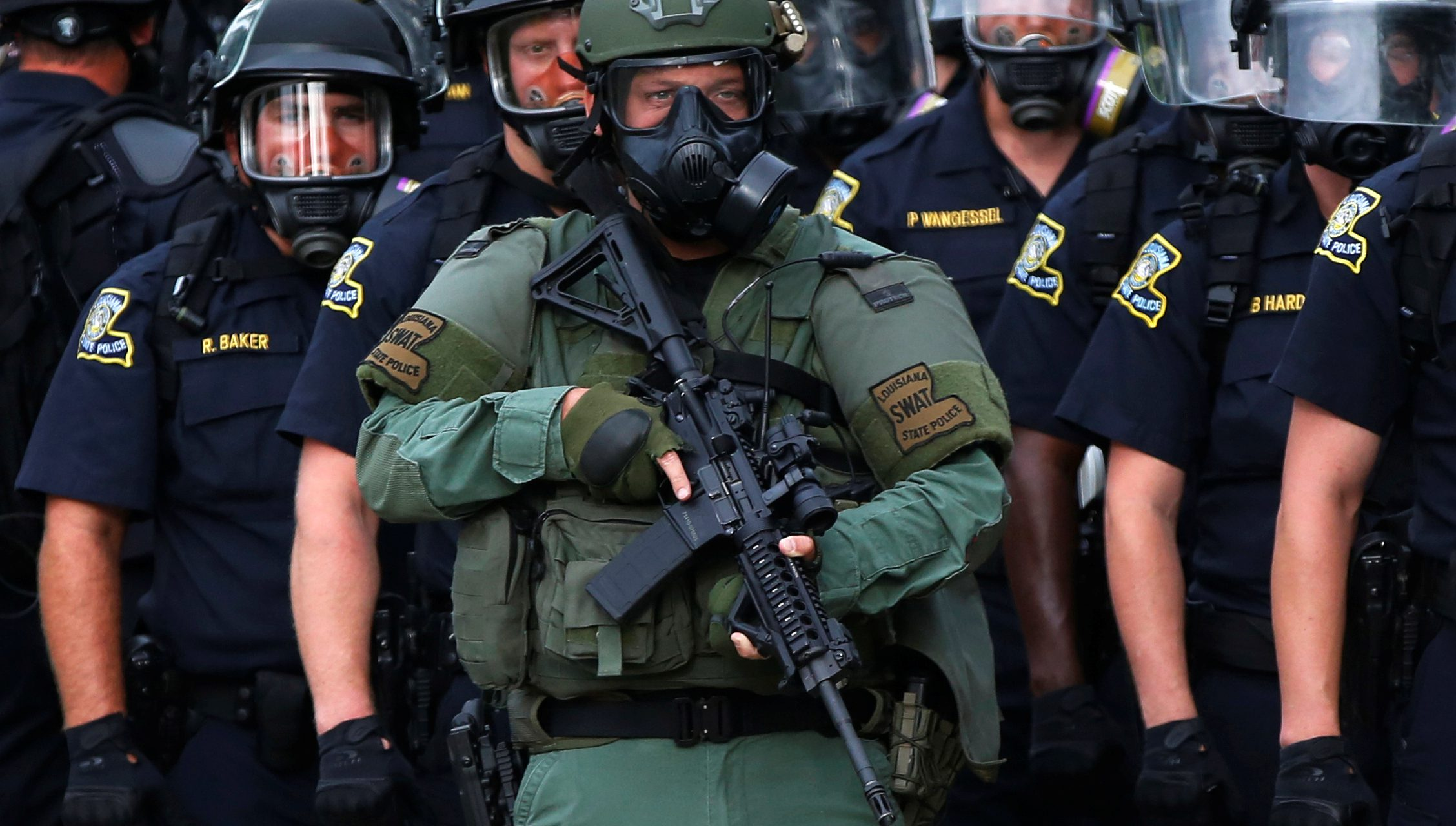 Why do American police officers dress like soldiers, and does it