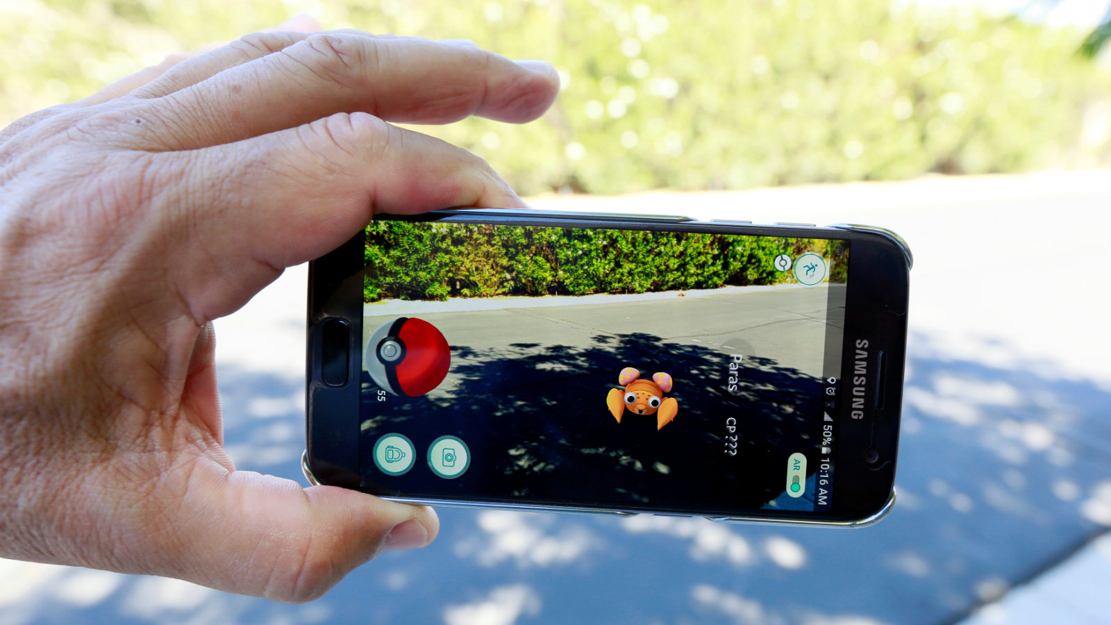 """The augmented reality mobile game """"Pokemon Go"""" by Nintendo is shown on a smartphone screen in this photo illustration taken in Palm Springs, California U.S. July 11, 2016."""