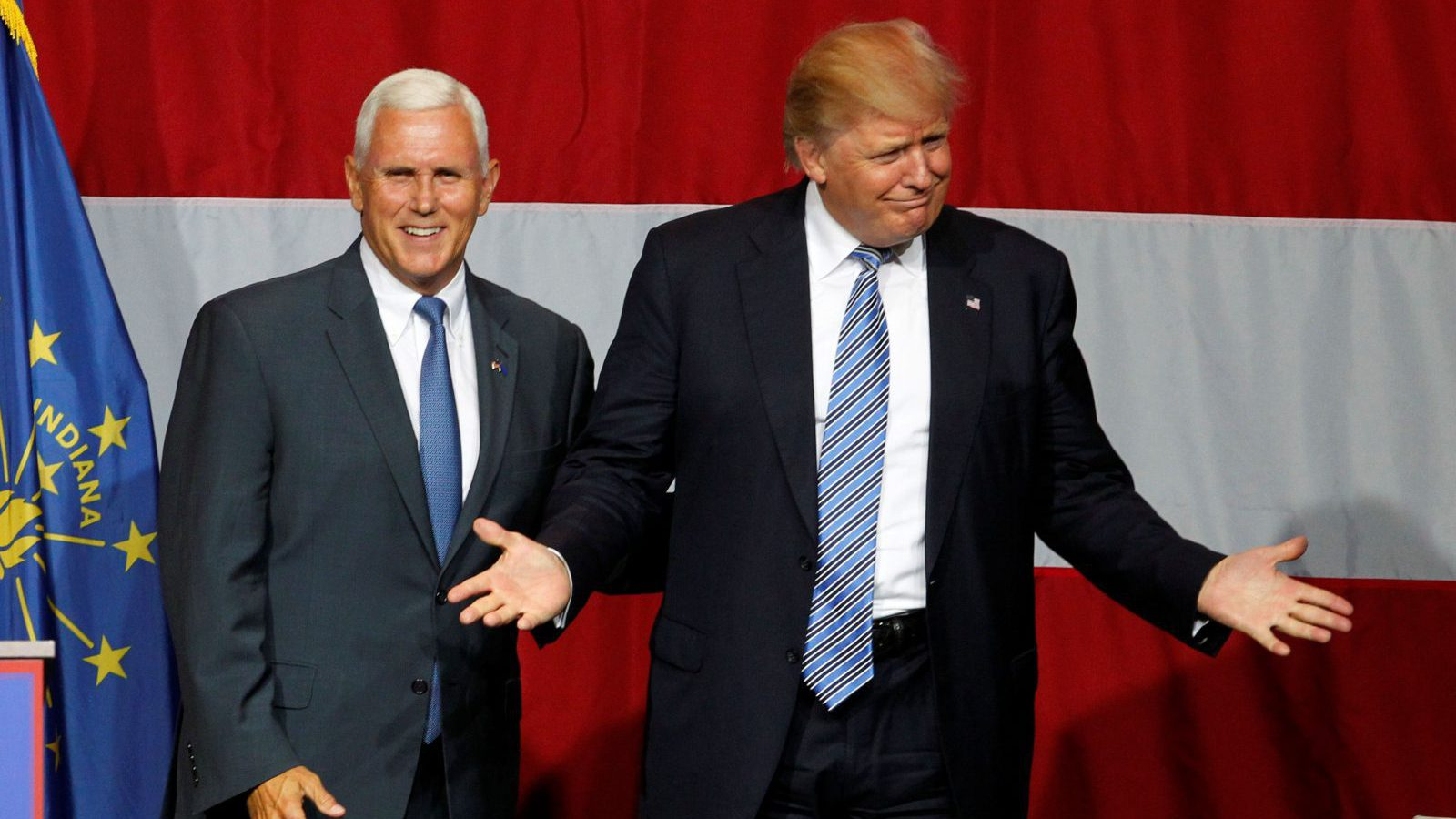 Republican U.S. presidential candidate Donald Trump (R) and Indiana Governor Mike Pence (L) wave to the crowd before addressing the crowd during a campaign stop at the Grand Park Events Center in Westfield, Indiana, July 12, 2016. REUTERS/John Sommers II - RTSHNE6