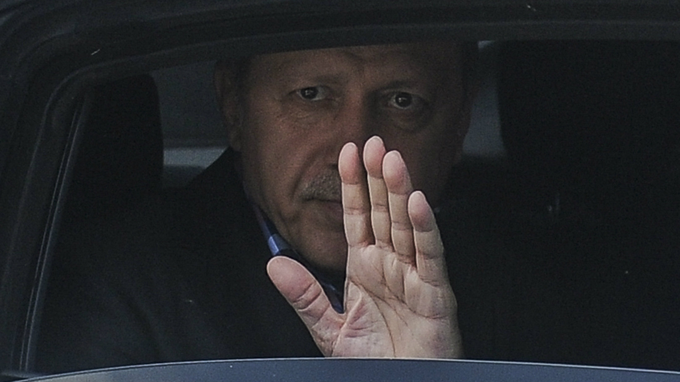urkish President Recep Tayyip Erdogan waves from his car after leaving his residence in Istanbul to attend a funeral service for the victims of a thwarted coup at Fatih mosque in Istanbul, Turkey, July 17, 2016.