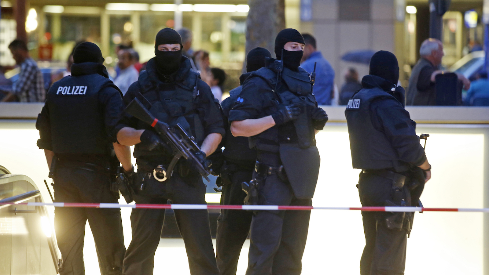 Special forces police officers stand guard at entrance of main train station following shooting rampage at shopping mall in Munich
