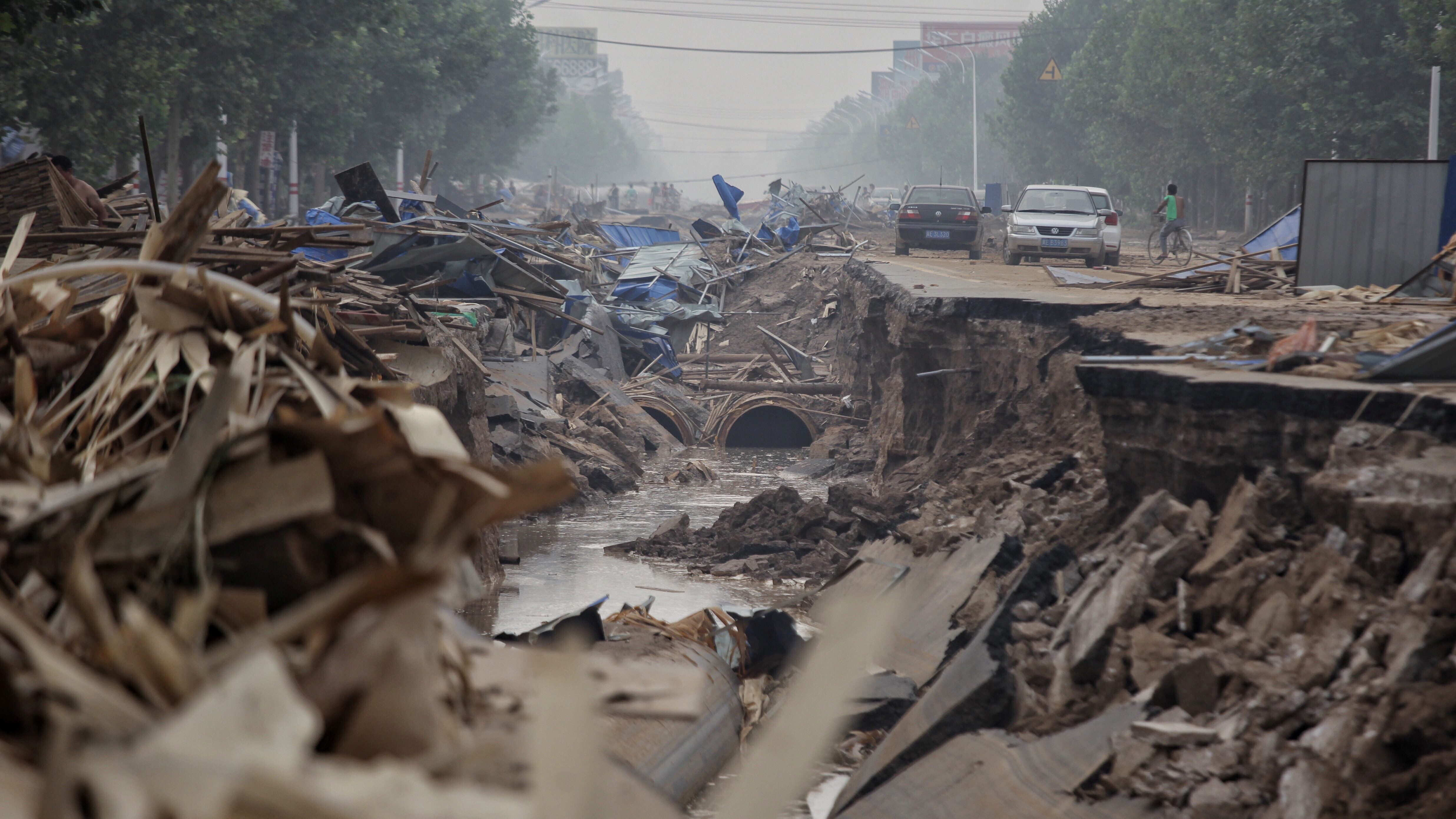 A road is seen damaged after floods in Xingtai