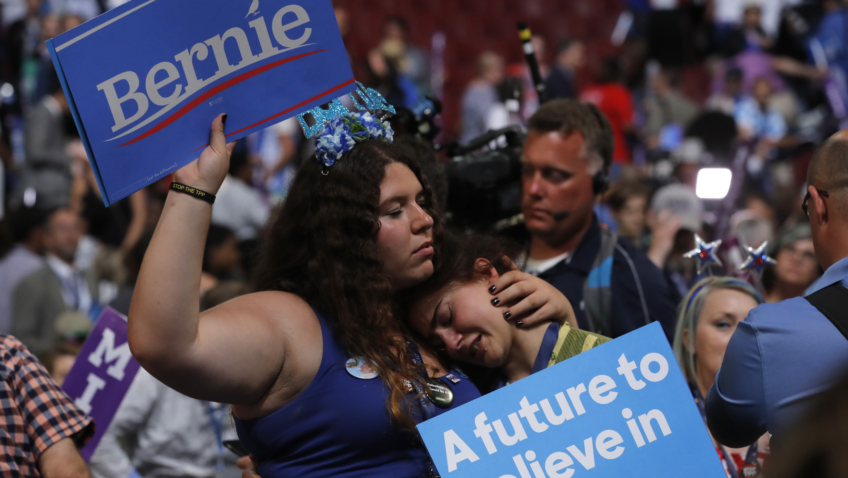 Two supporters of former Democratic U.S. presidential candidate Sanders hug at the end of Sanders' speech during the first session at the Democratic National Convention in Philadelphia
