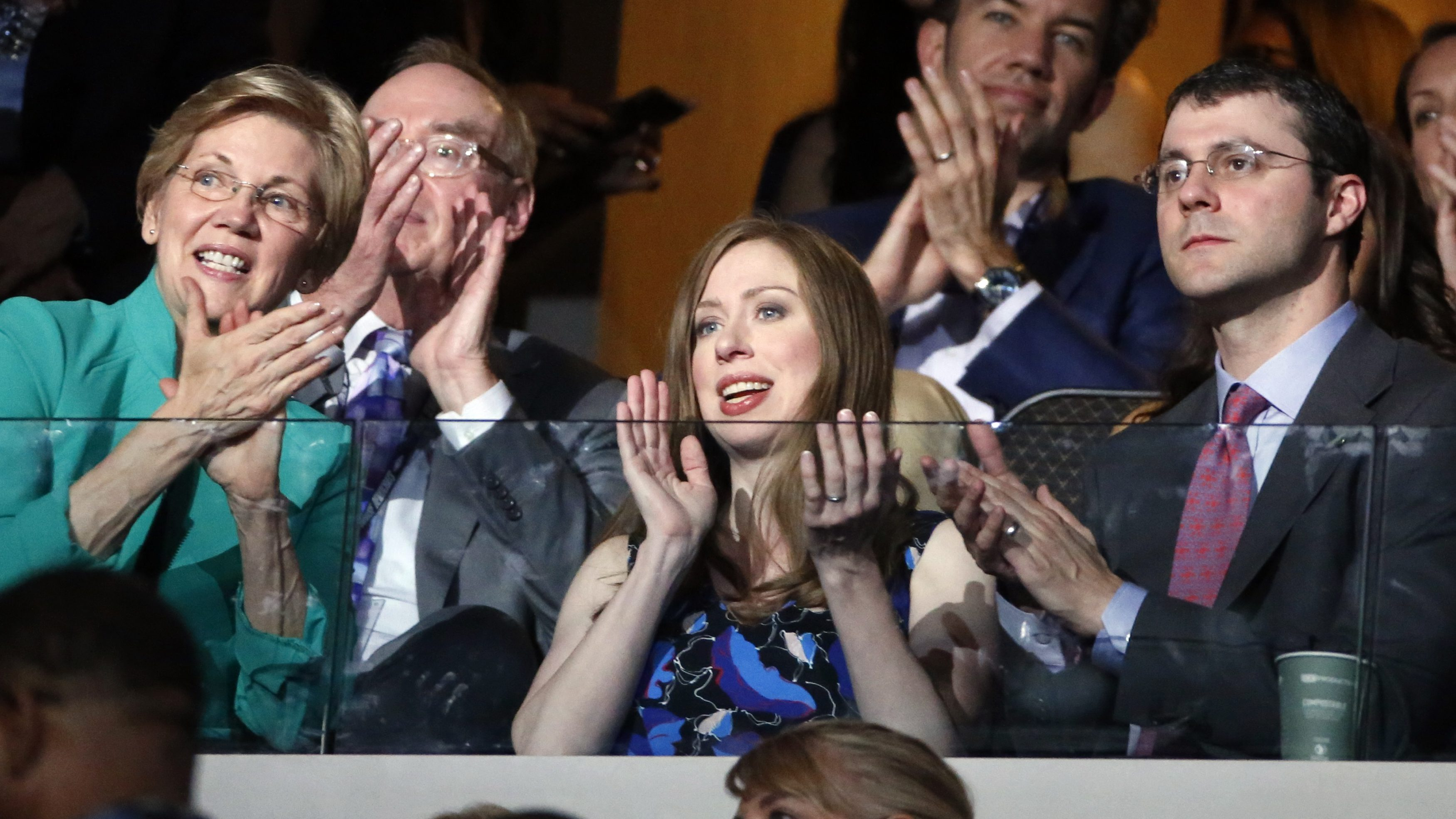 Senator Elizabeth Warren (D- MA) (L) and her husband Bruce Mann applaud with Cheslea Clinton and her husband Marc Mezvinsky during the Democratic National Convention in Philadelphia, Pennsylvania, U.S. July 26, 2016.