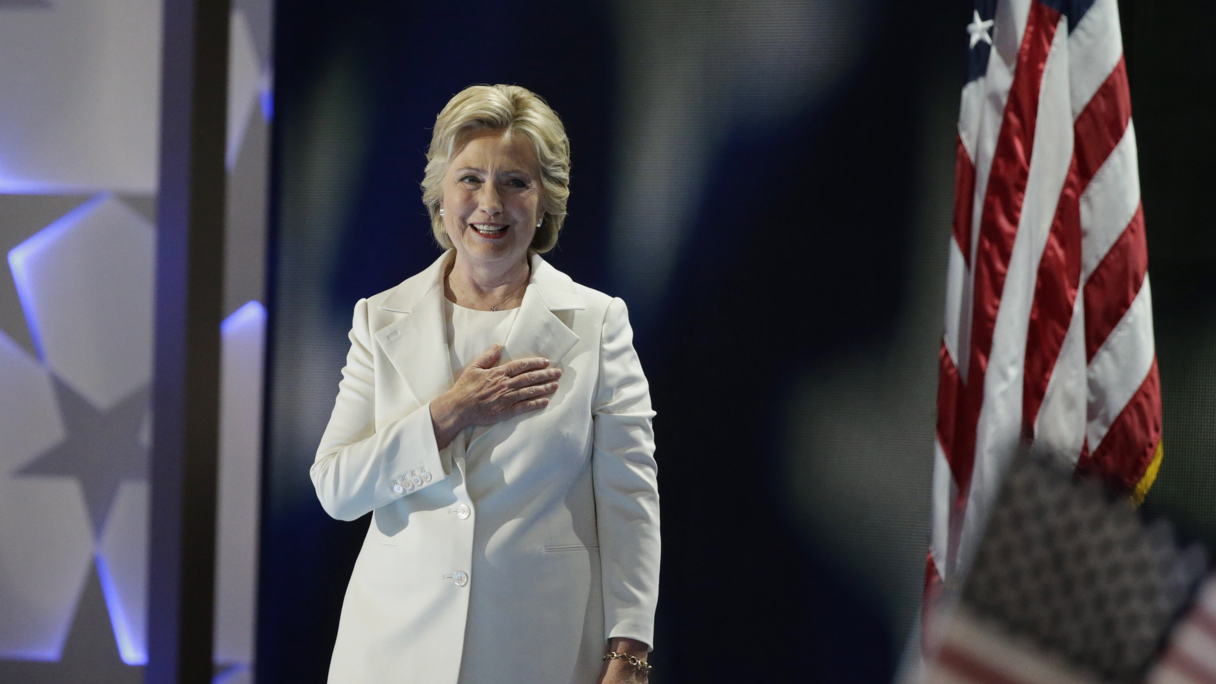 Democratic presidential nominee Hillary Clinton places her hand on her heart as she arrives onstage to accept the nomination on the fourth and final night at the Democratic National Convention in Philadelphia, Pennsylvania, U.S. July 28, 2016. REUTERS/Gary Cameron TPX IMAGES OF THE DAY