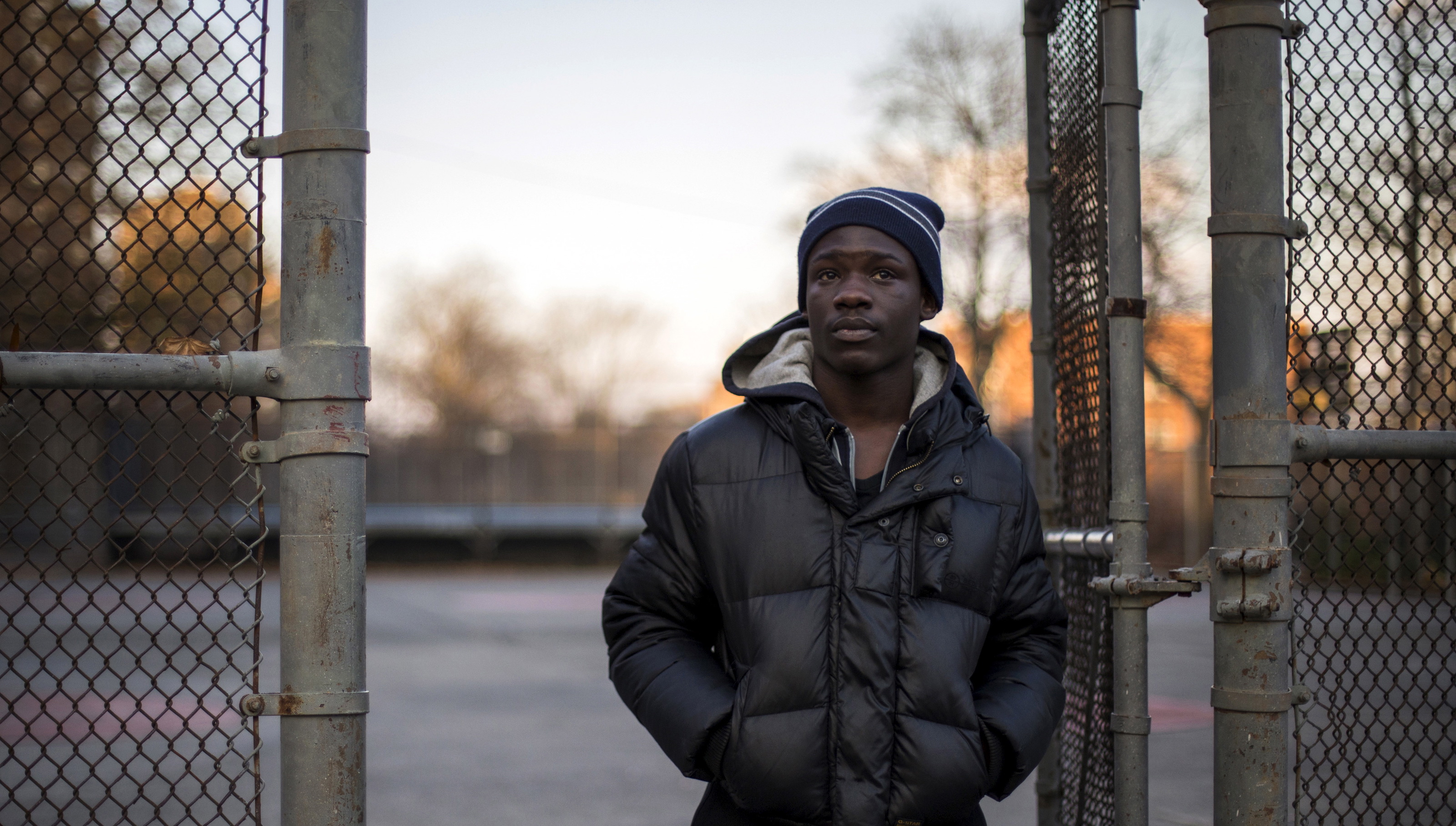 """Eric, 19, who did not want to share his full name, poses for a photograph in a playground outside his residence in the Bronx borough of New York, November 20, 2014. Eric says he was 17 years-old in 2012 when he was incarcerated on Rikers Island for committing """"A crime which was illegal."""" During a search on the school grounds where inmates attend class, Eric says he was ordered to strip naked. When he refused, he says he """"Got put in a headlock, officers started beating on me, punching me in my head, my body, kicking me, had me in fetal position, stomping on me."""" Directly after the incident Eric says the officers """"put me in flexicuffs then they (pepper) spray.""""  Eric say he was sent to solitary confinement after the incident because officers """"Said I assaulted an officer and that was that."""" When describing his experience at Rikers, he says """"Coming from the street to there just had me on guard. Being observant and just didn't want to become a victim, which I did. After that, it just made me be more aggressive and hostile."""" Rikers, one of the largest jail complexes in the country which houses around 9,800 prisoners, came under scrutiny after the Justice Department in August 2014 issued a report that described a pattern of violent abuse of male inmates aged 16 to 18 by jail staff. In response to questions from Reuters, a spokesman for Rikers Island Department of Correction (DOC) said that, """"Since Commissioner (Joseph) Ponte's appointment last year, he has significantly reformed the care and custody of adolescent inmates, resulting in substantial decline in violence in the adolescent facility."""" The spokesman added that safety for staff and inmates is Commissioner Ponte's """"top priority"""" and that """"DOC has a  zero-tolerance police with regards to abuse."""" Reuters has been unable to independently verify the statements provided by the individual in this portrait. Picture taken November 20, 2014. REUTERS/Elizabeth Shafiroff - RTX1MUA9"""