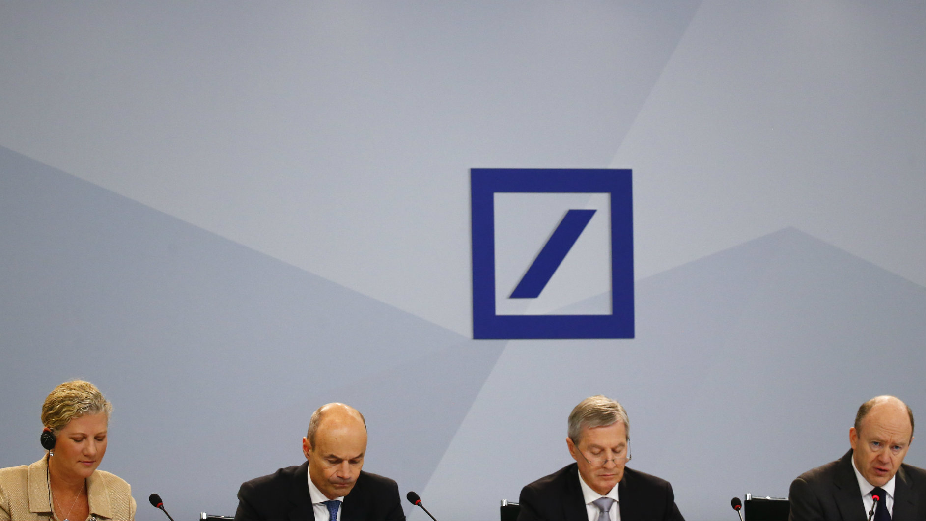 Deutsche Bank COO Kim Hammonds, CFO Marcus Schenck, co-CEO Juergen Fitschen and Chief Executive John Cryan (L-R) attend a news conference in Frankfurt, Germany, January 28, 2016. Deutsche Bank Chief Executive John Cryan urged investors to bear with him as he expects the overhaul of Germany's biggest lender to peak this year, following a record loss in 2015.