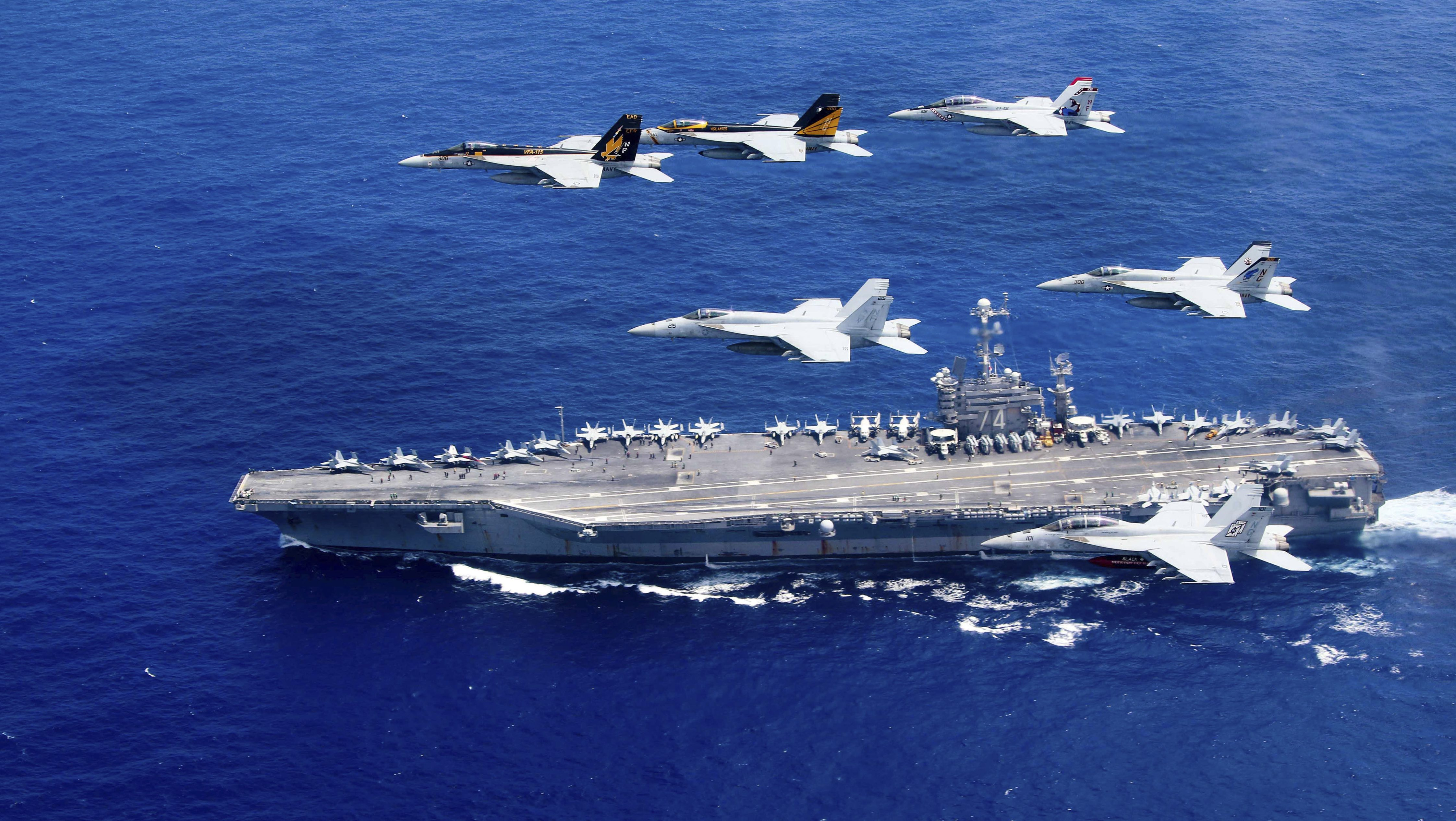 A combined formation of aircraft from Carrier Air Wing (CVW) 5 and Carrier Air Wing (CVW) 9 pass in formation above the Nimitz-class aircraft carrier USS John C. Stennis (CVN 74) in the Philippine Sea on June 18, 2016.     Courtesy Steve Smith/U.S. Navy/Handout via REUTERS  ATTENTION EDITORS - THIS IMAGE WAS PROVIDED BY A THIRD PARTY. EDITORIAL USE ONLY - RTX2GYG6