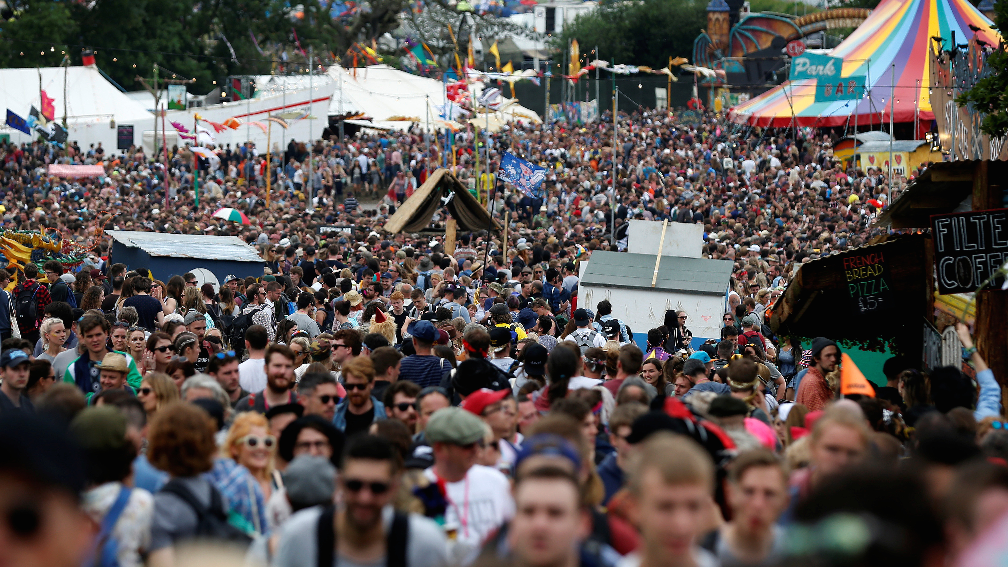 Revellers walk near The Park stage during the Glastonbury Festival at Worthy Farm in Somerset