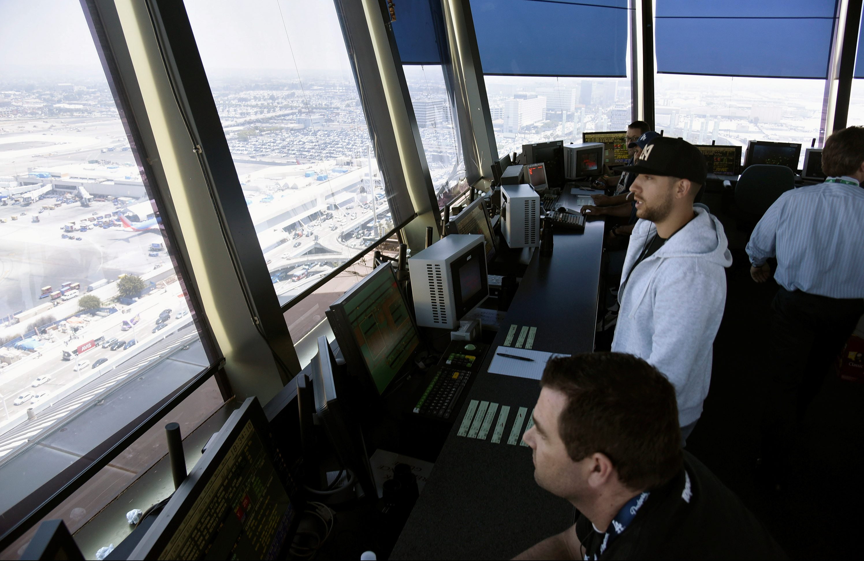 Air traffic controllers talk with pilots inside the control tower at Los Angeles International Airport (LAX) in  Los Angeles, California