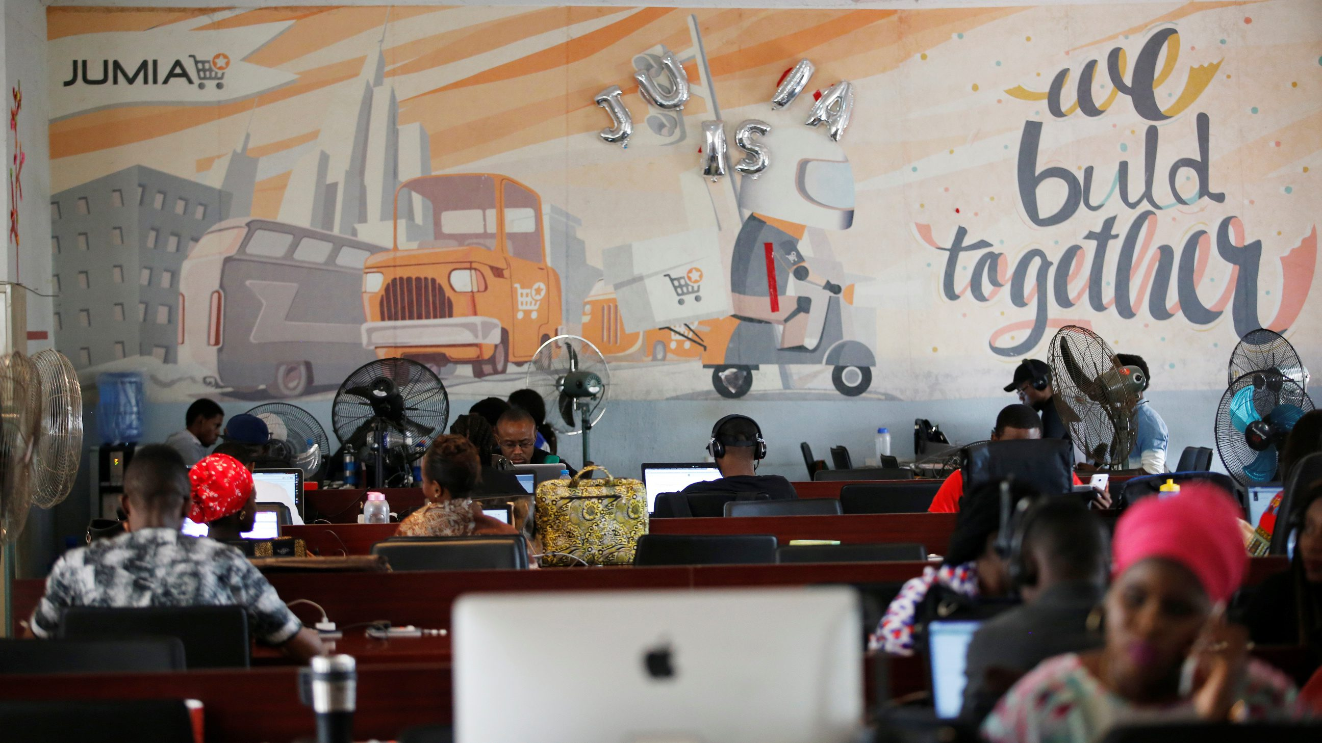 People work on computers at the online store Jumia in Ikeja district, in Lagos
