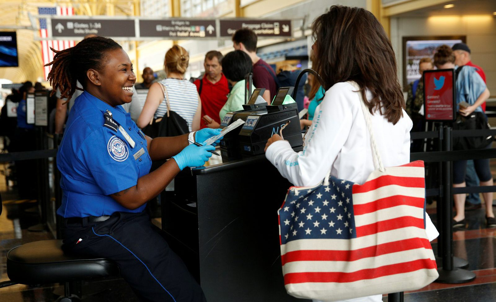Woman passes though a TSA checkpoint at Reagan National Airport in Washington