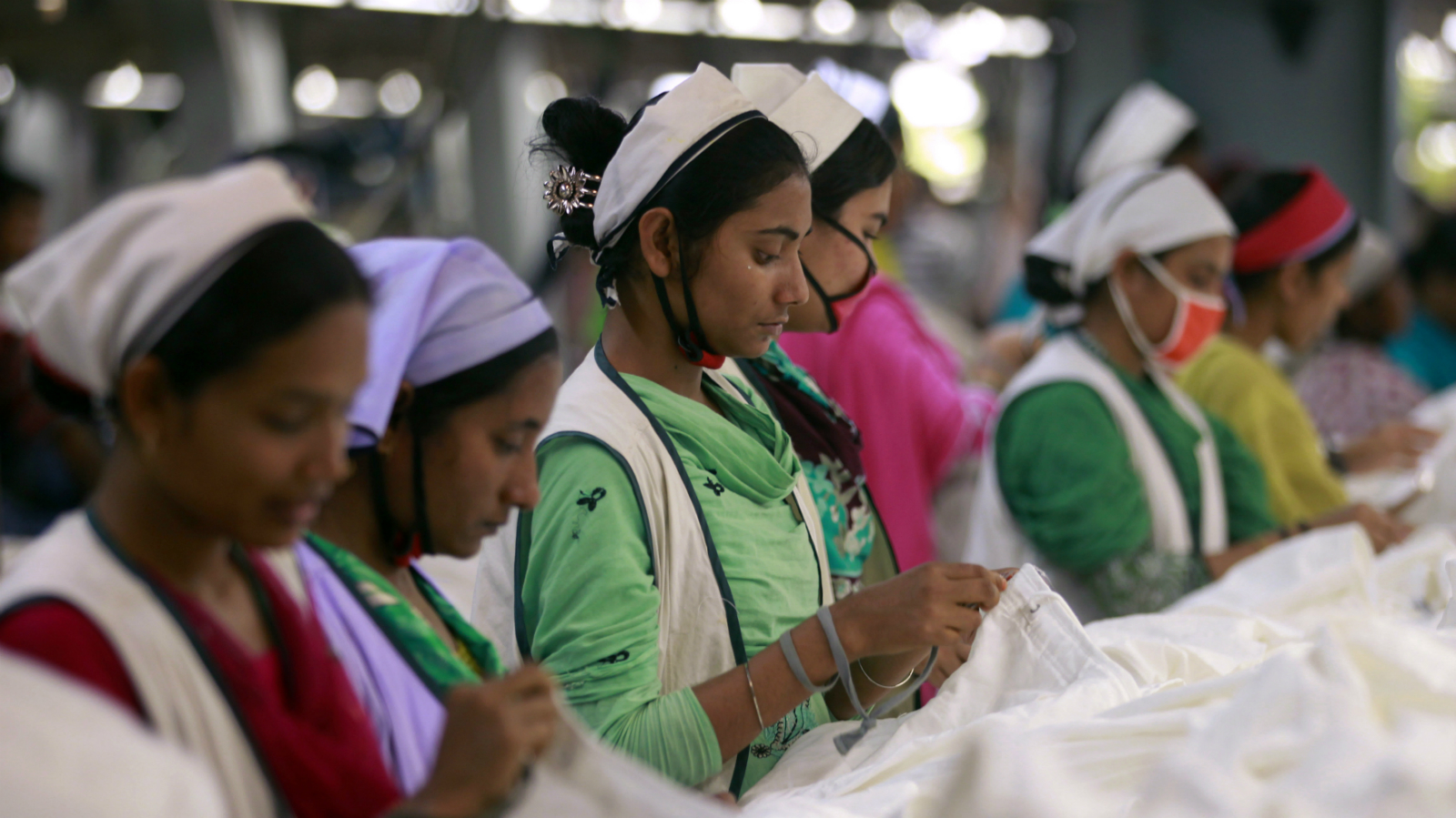 Women work at Goldtex Limited garment factory inside the Dhaka Export Processing Zone (DEPZ) in Savar April 11, 2013.