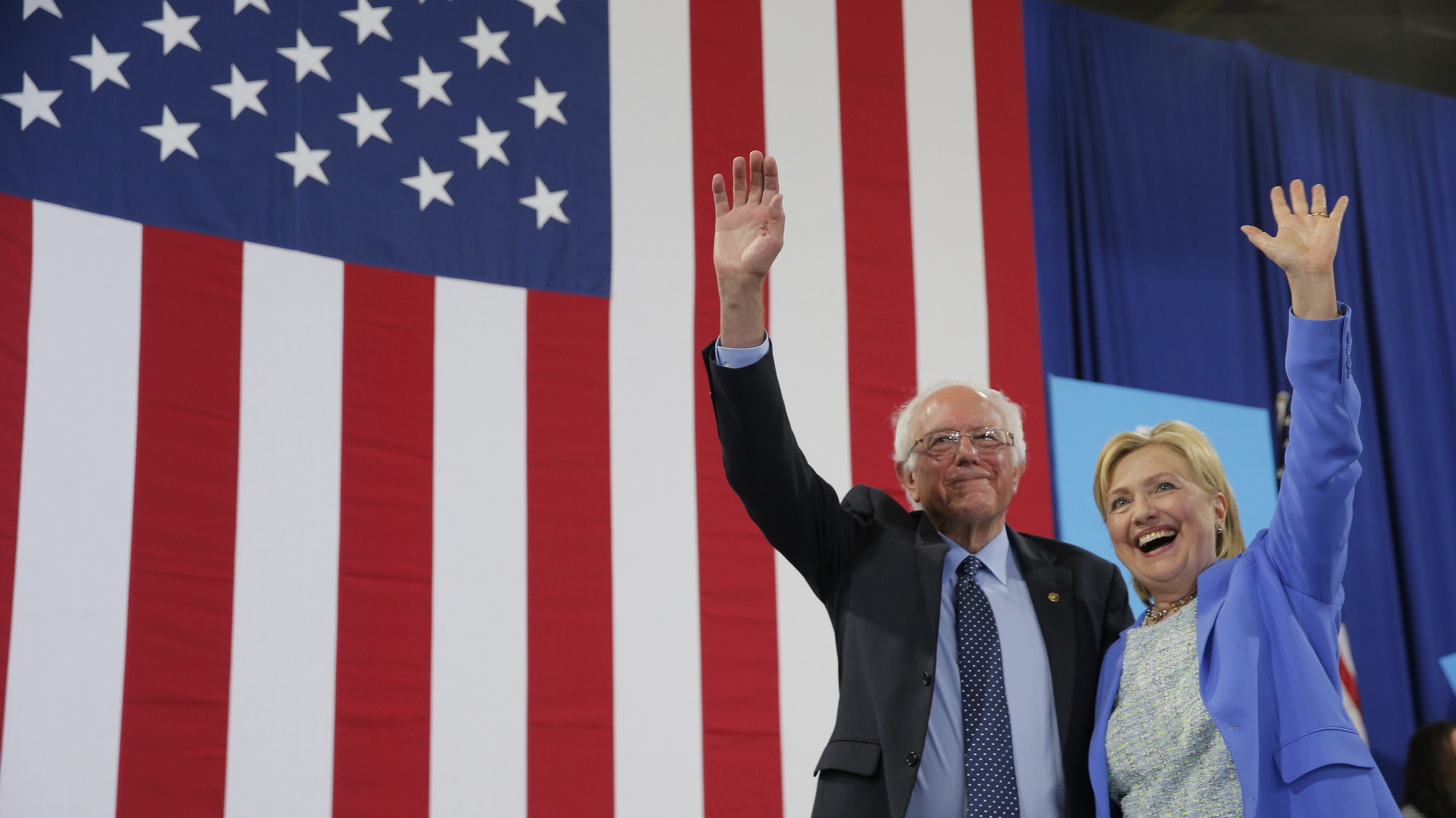Democratic candidates Hillary Clinton (right), the presumptive nominee, and Bernie Sanders (left).