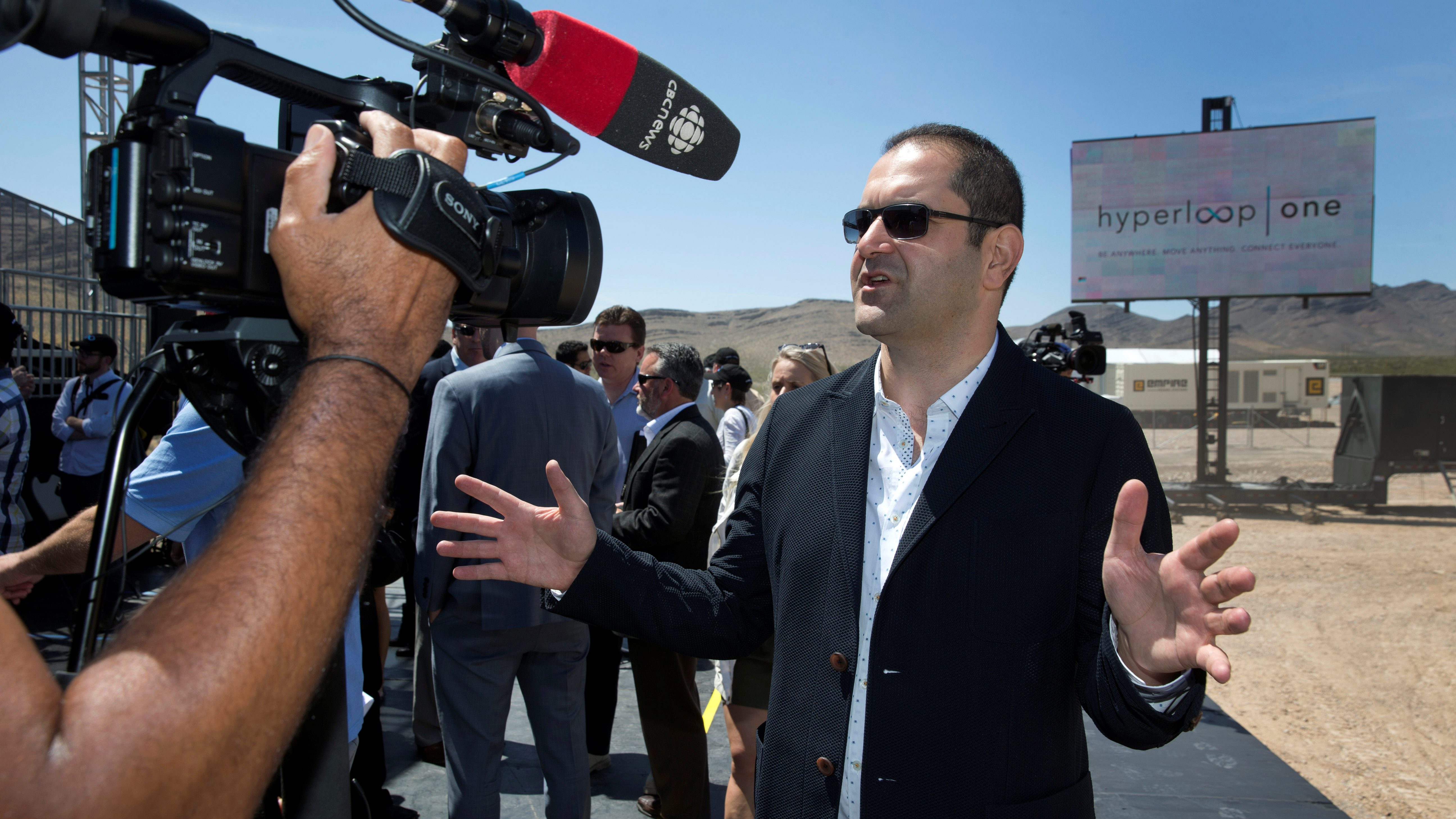 Hyperloop One co-founder Shervin Pishevar speaks to reporters following a propulsion open-air test at Hyperloop One in North Las Vegas, Nevada, U.S. May 11, 2016. REUTERS/Steve Marcus - RTX2DWES