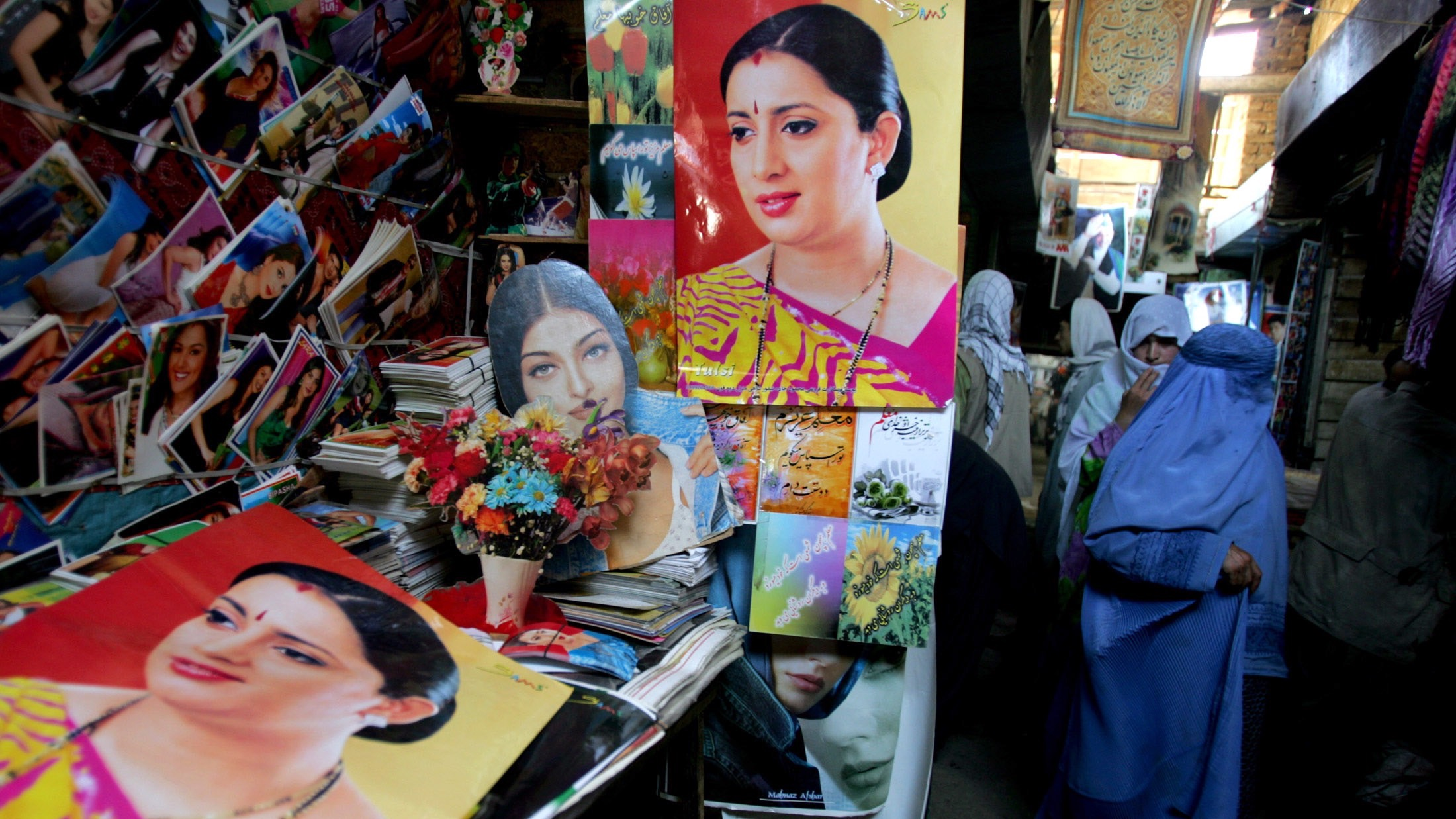 """Posters of Indian actress Smriti Irani who plays Tulsi in the family series called """"Saas Bhi Kabhi Bahu Thi"""" are on sale at a market in Kabul, Afghanistan May 14, 2006. The television drama is hugely popular in Afghanistan, where for the first time after decades of war, people are able to see a series that explores many of the issues they encounter in their own lives. Picture taken May 14, 2006. To match feature AFGHAN-SOAPOPERA   REUTERS/Ahmad Masood - RTR1DG0Q"""