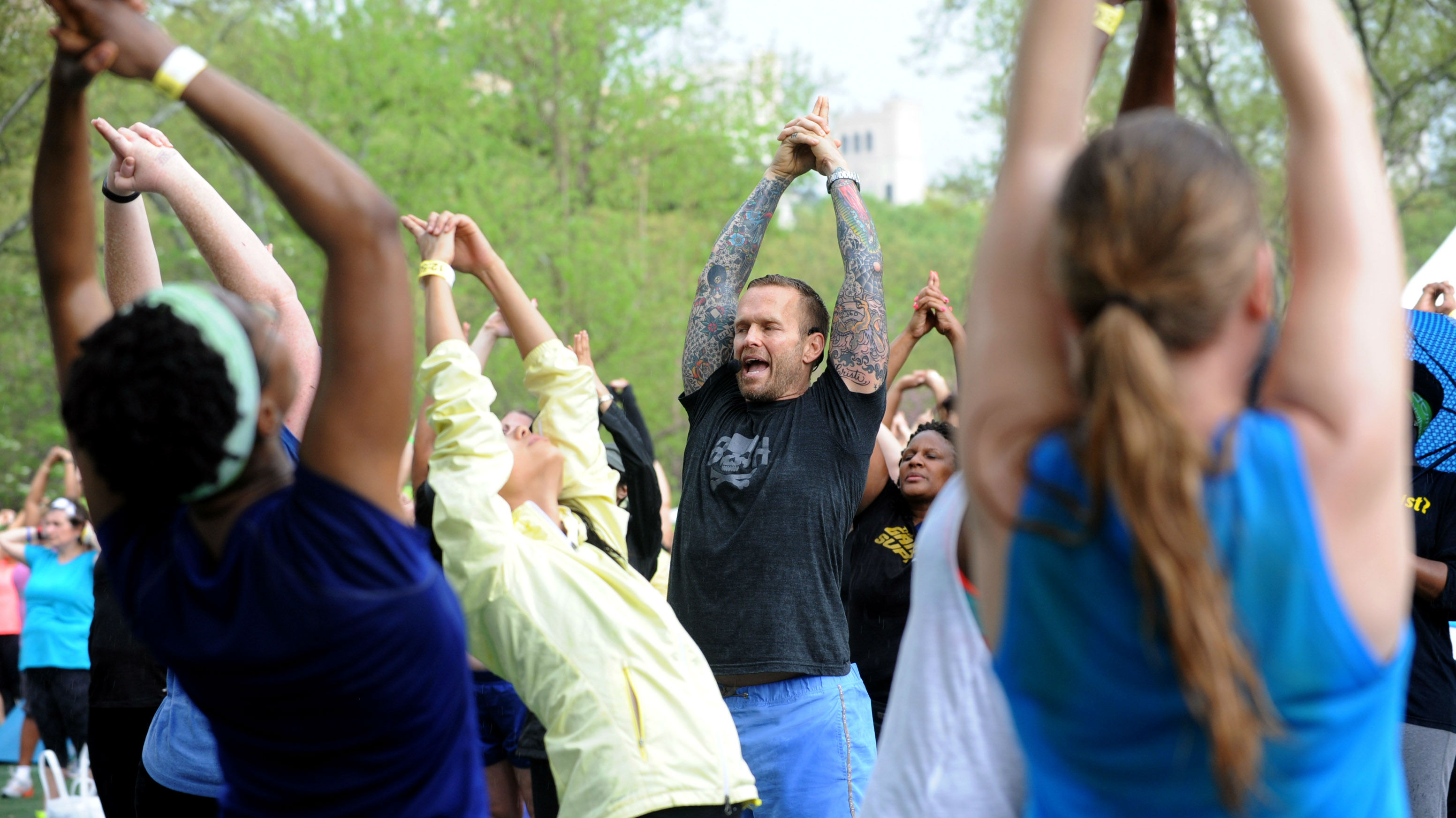 """Bob Harper, trainer on """"The Biggest Loser,"""" stretches after leading a body-blasting class at SELF magazine's 21st annual Workout in the Park, Saturday, May 10, 2014, in New York's Central Park."""