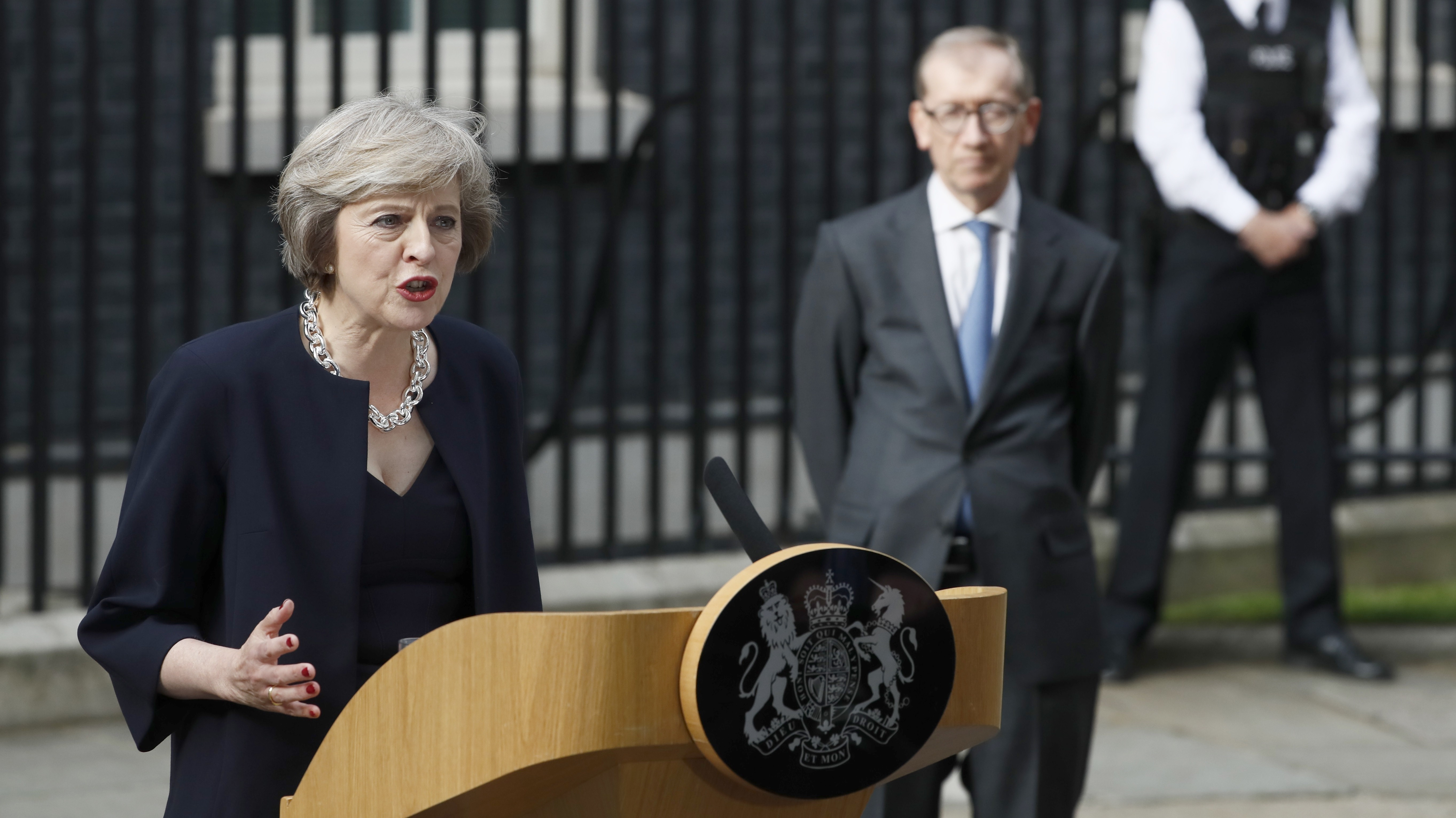 Britain's Prime Minister, Theresa May, watched by husband Philip, speaks to the media outside number 10 Downing Street, in central London, Britain July 13, 2016.    REUTERS/Stefan Wermuth  - RTSHRW6