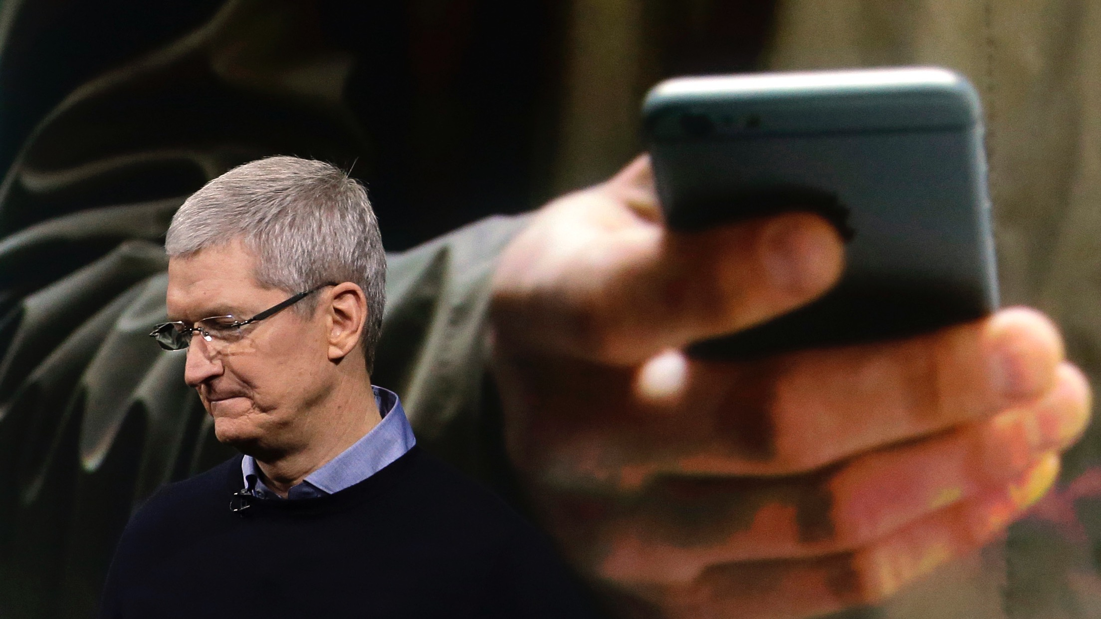 In this March 21, 2016 photo, Apple CEO Tim Cook speaks at an event to announce new products at Apple headquarters in Cupertino, Calif.  Companies like Apple and Microsoft pushing back against the surveillance state in the courts, arguing that federal authorities have overstepped their legal authority to obtain your chats, email and other crucial information from phones and online services.(AP Photo/Marcio Jose Sanchez)