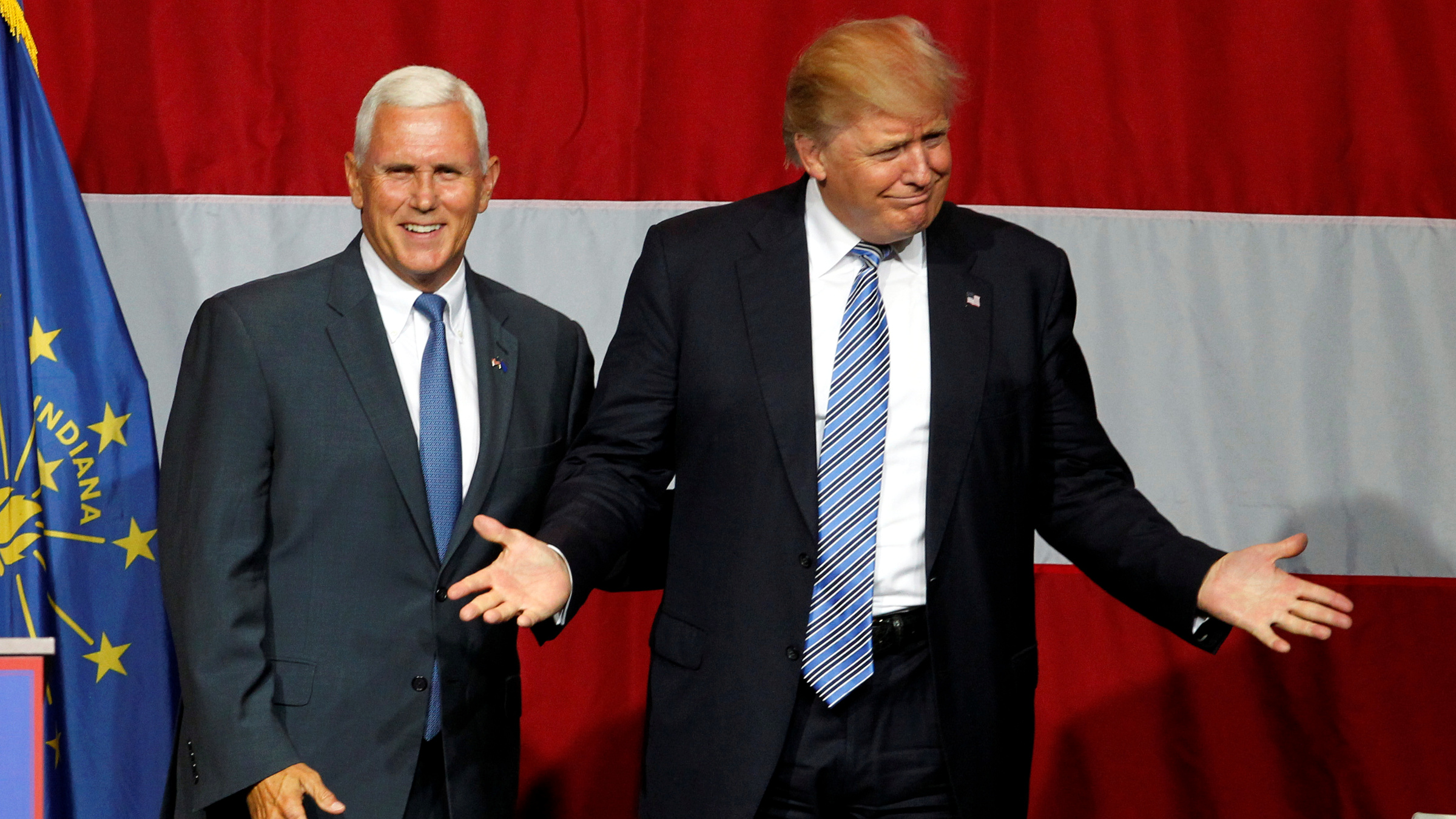 Republican U.S. presidential candidate Donald Trump (R) and Indiana Governor Mike Pence (L) wave to the crowd before addressing the crowd during a campaign stop at the Grand Park Events Center in Westfield, Indiana, July 12, 2016.
