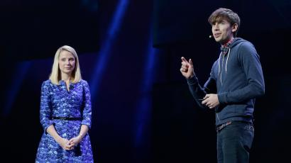Yahoo president and CEO Marissa Mayer, left, listens as Tumblr CEO David Karp speaks during a Yahoo presentation at the International Consumer Electronics Show, Tuesday, Jan. 7, 2014, in Las Vegas. (AP Photo/Julie Jacobson)