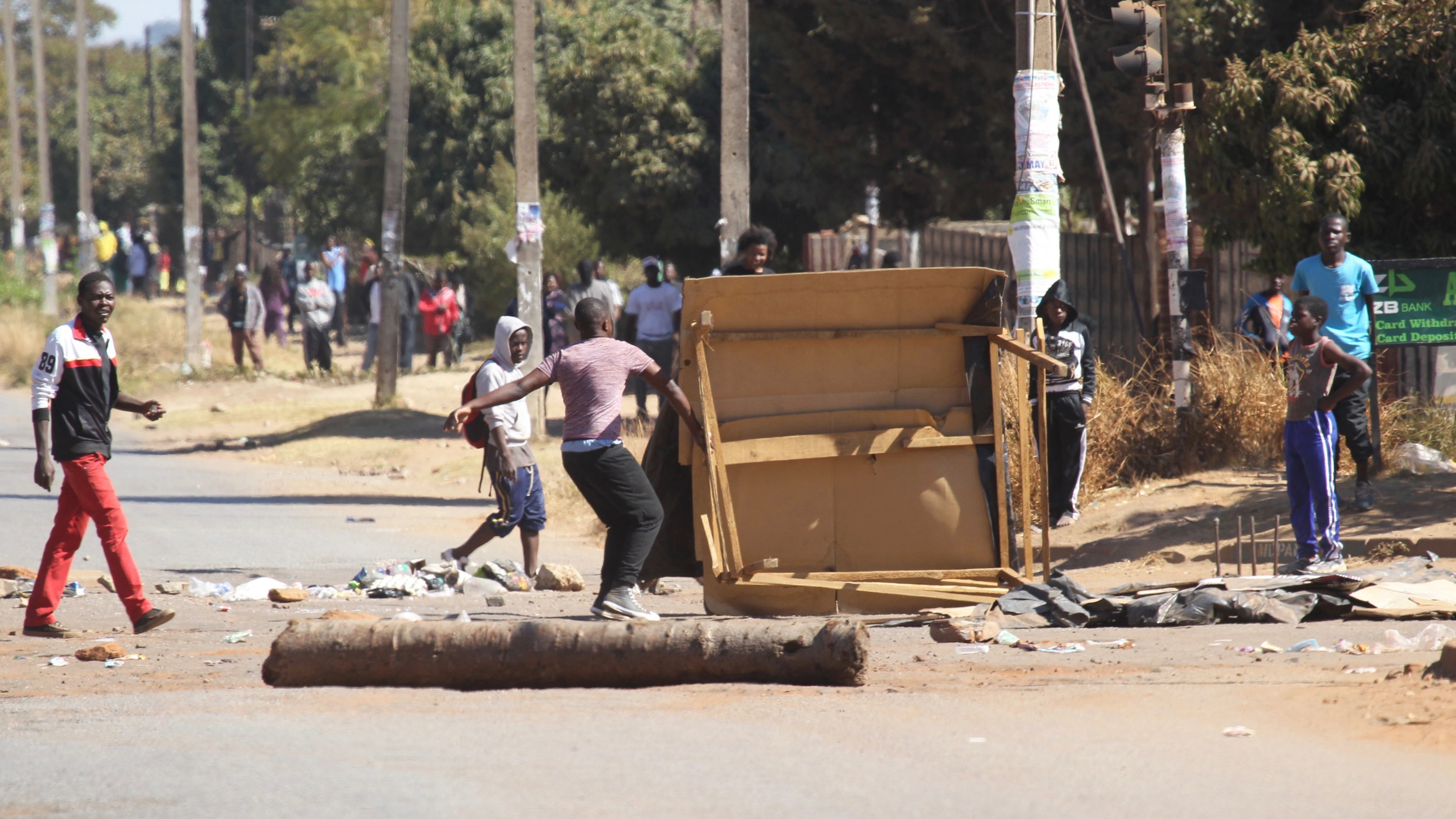 Protestors  block a road leading to the city  following a job boycott called via social media  platforms in Harare, Wednesday, July,6, 2016. The boycott shut down most  of  Zimbabwe as discontent  deepens  over  increasing economic hardships  under President Robert Mugabe's rule.