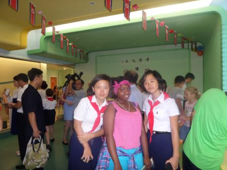 A student from Tanzania poses with her new North Korean friends at the Songdowon summer camp in 2015.