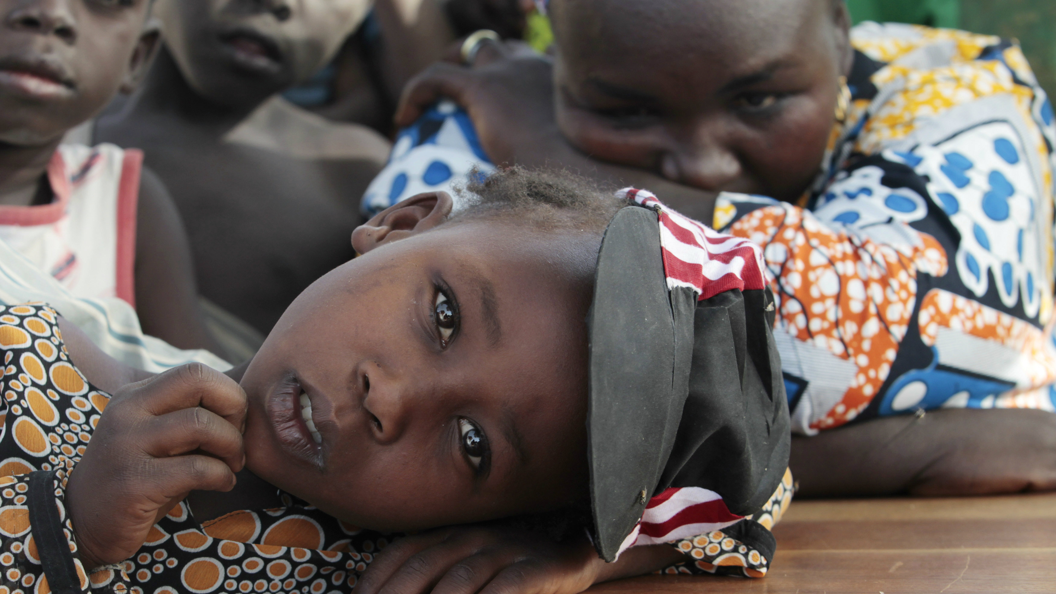 A girl displaced as a result of Boko Haram attack in the northeast region of Nigeria, rests her head on a desk at Maikohi secondary school camp for internally displaced persons (IDP) in Yola, Adamawa State January 13, 2015.