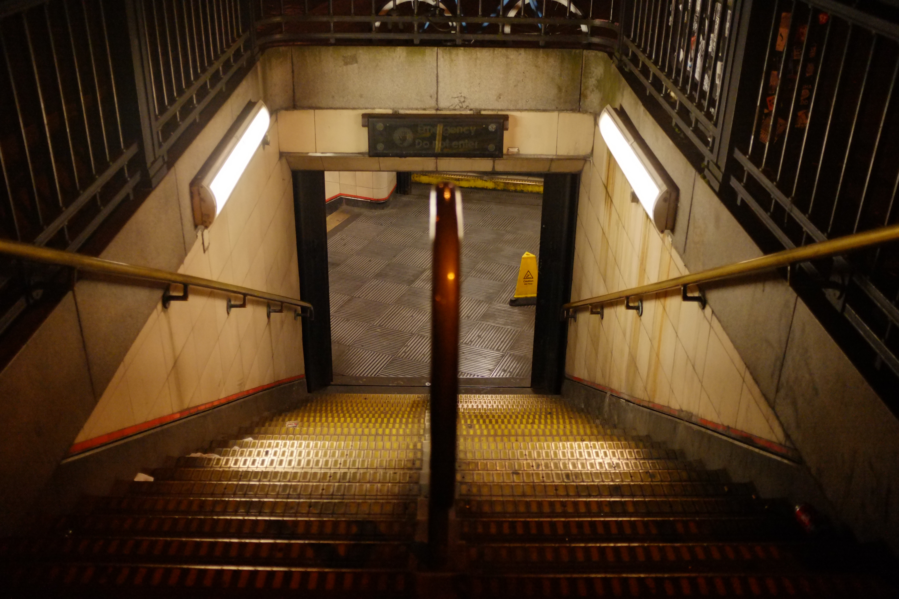 Amber-lit-stairs-of-Bethnal-Green-London-Tube-Station