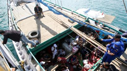 A boat carrying Iranian asylum seekers is intercepted in Indonesian waters en route to Australia.