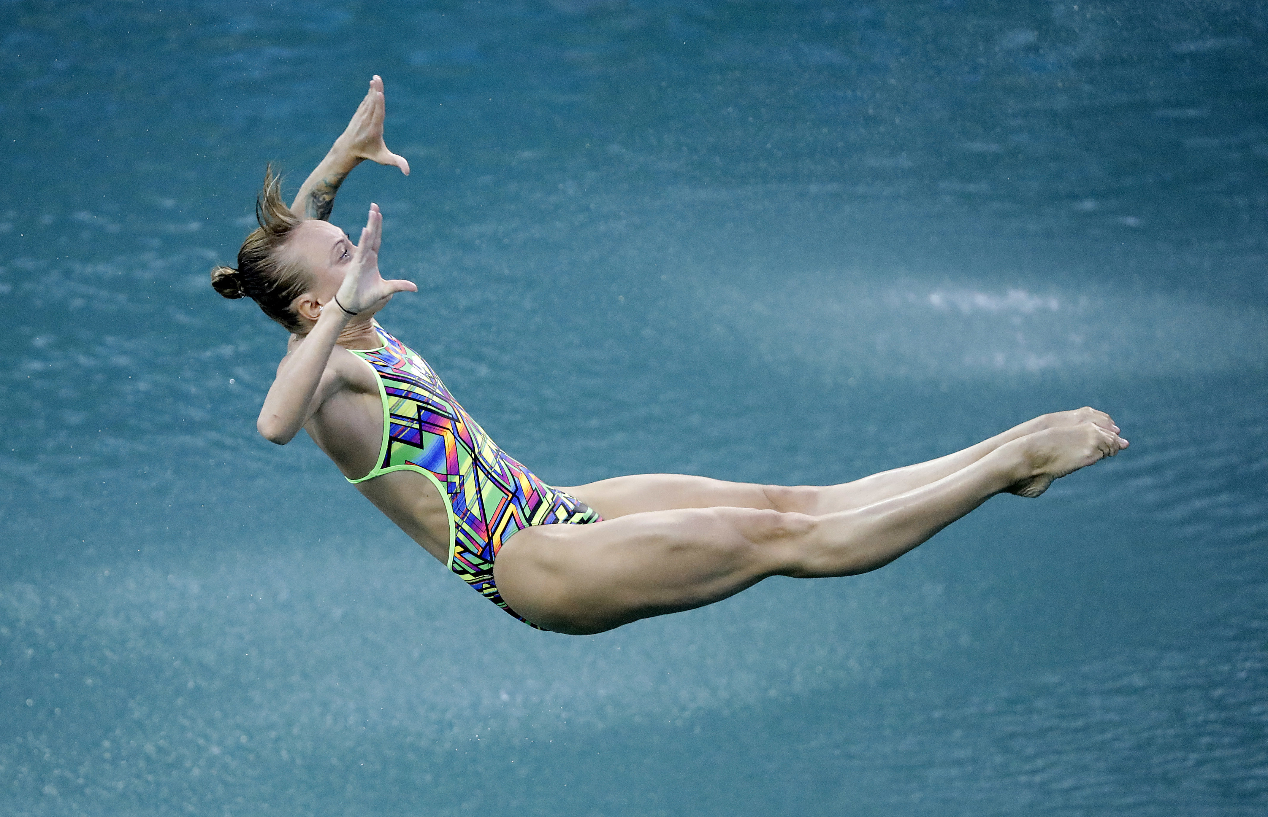Russia's Nadezhda Bazhina competes during the women's 3-meter springboard diving preliminary round.