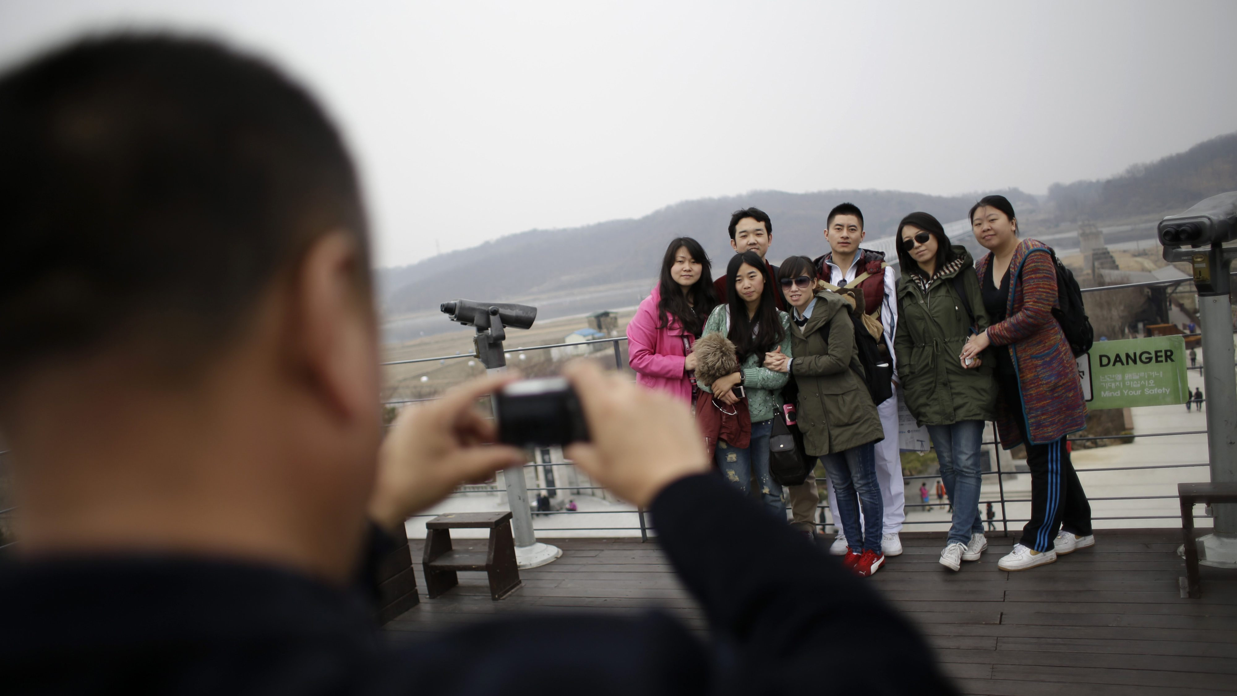 Chinese tourists take pictures at the Imjingak Pavilion near the border village of Panmunjom, dividing the two Koreas since the Korean War, in Paju, north of Seoul, South Korea, April 5, 2013.