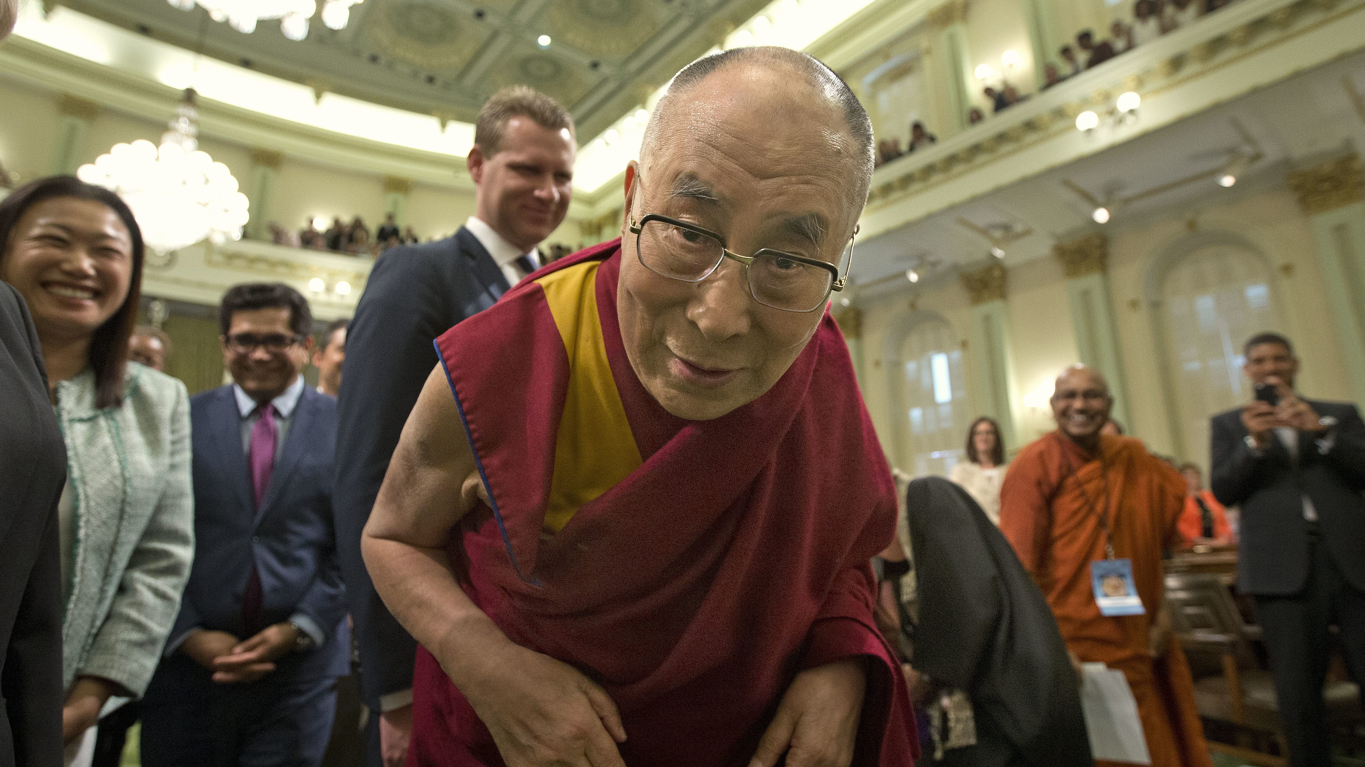 The Dalai Lama poses for a closeup as he enters the California Assembly Chambers to address a joint session of the California Legislature, Monday, June 20, 2016, in Sacramento, Calif. (AP Photo/Rich Pedroncelli)