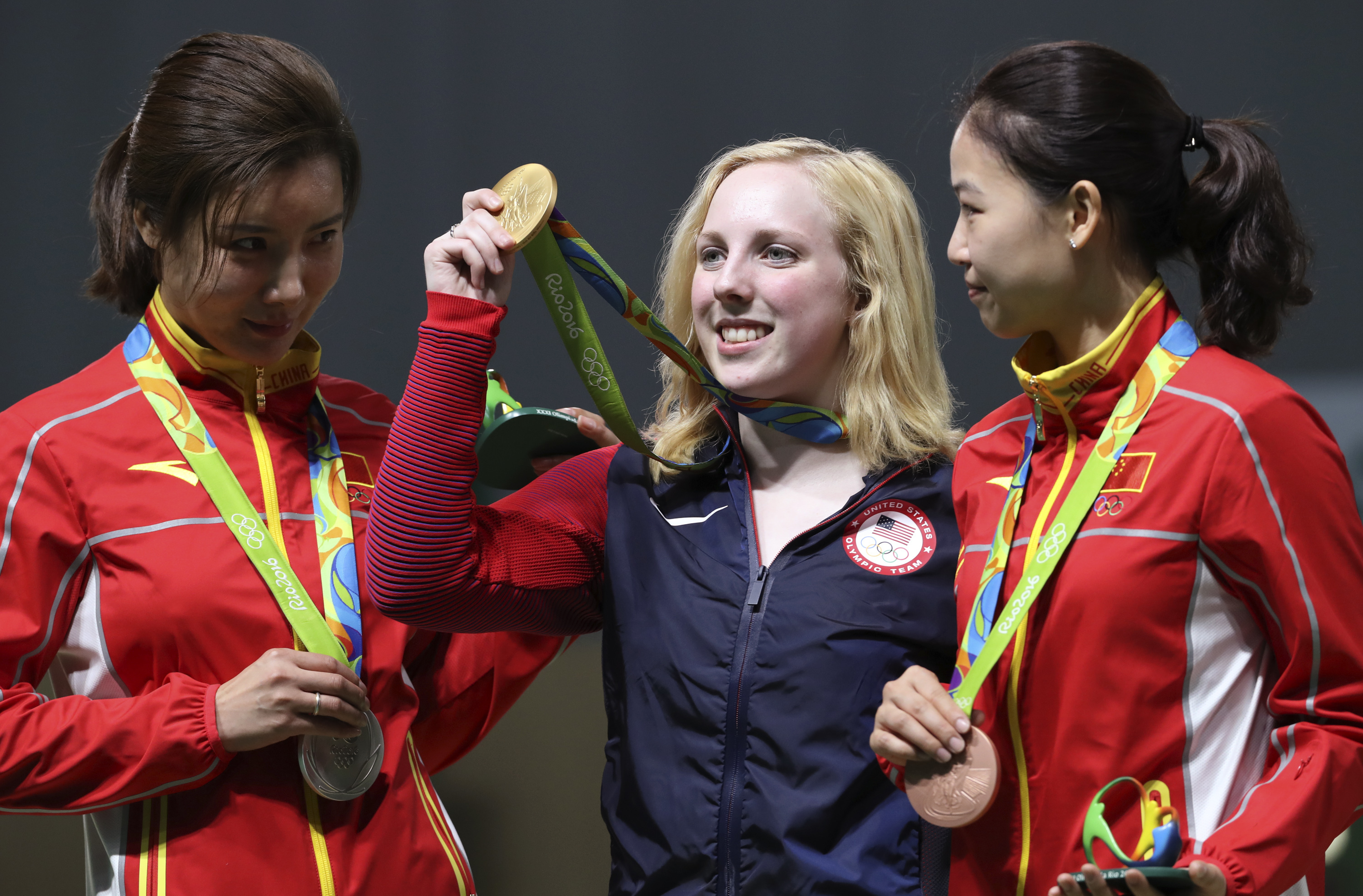 Virginia Thrasher, center, of the United States holds her gold medal for the Women's 10m Air Rifle competition during the award ceremony with the runner-up Du li, left, of China and third place Yi Siling, right, of China at Olympic Shooting Center at the 2016 Summer Olympics in Rio de Janeiro, Brazil, Saturday, Aug. 6, 2016. ()