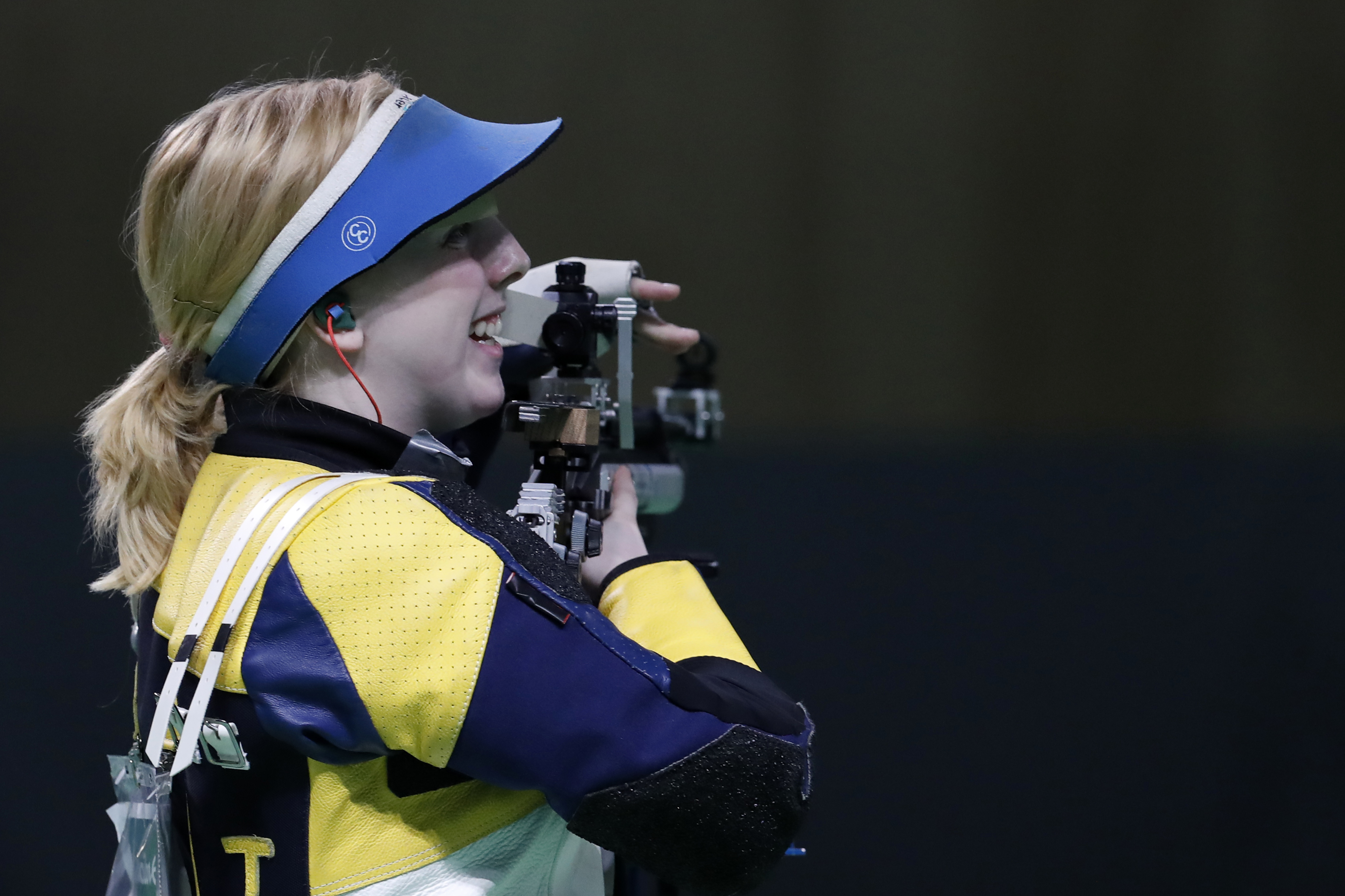 Virginia Thrasher of the United States smiles winning a shootout to secure the gold medal in the Women's 10m Air Rifle event at Olympic Shooting Center at the 2016 Summer Olympics in Rio de Janeiro, Brazil, Saturday, Aug. 6, 2016.