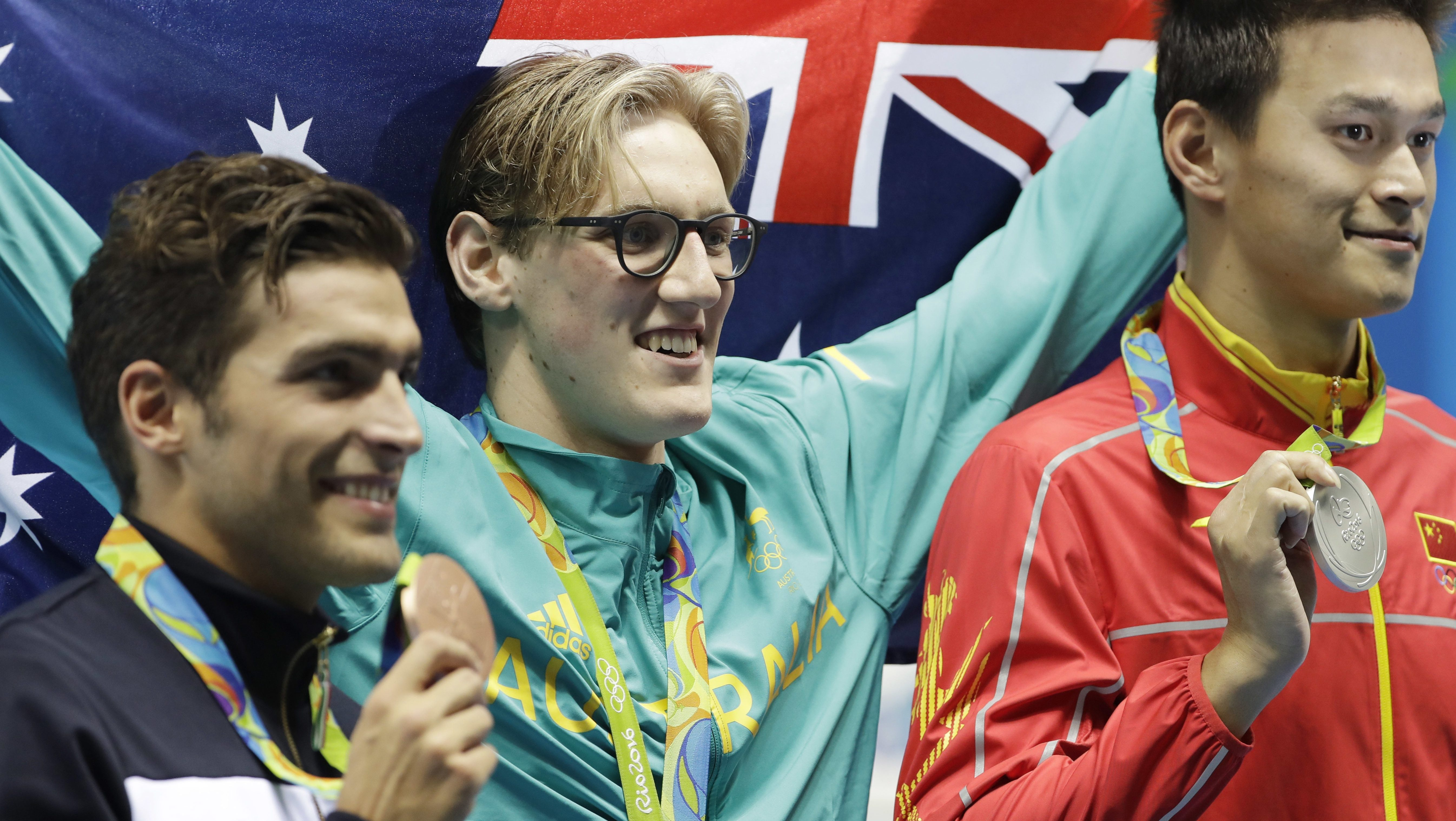 Australia's Mack Horton, center, second placed Italy's Gabriele Detti, left, and third placed China's Sun Yang hold their medals after the men's 400-meter freestyle during the swimming competitions at the 2016 Olympics, Aug. 6, in Rio de Janeiro, Brazil.
