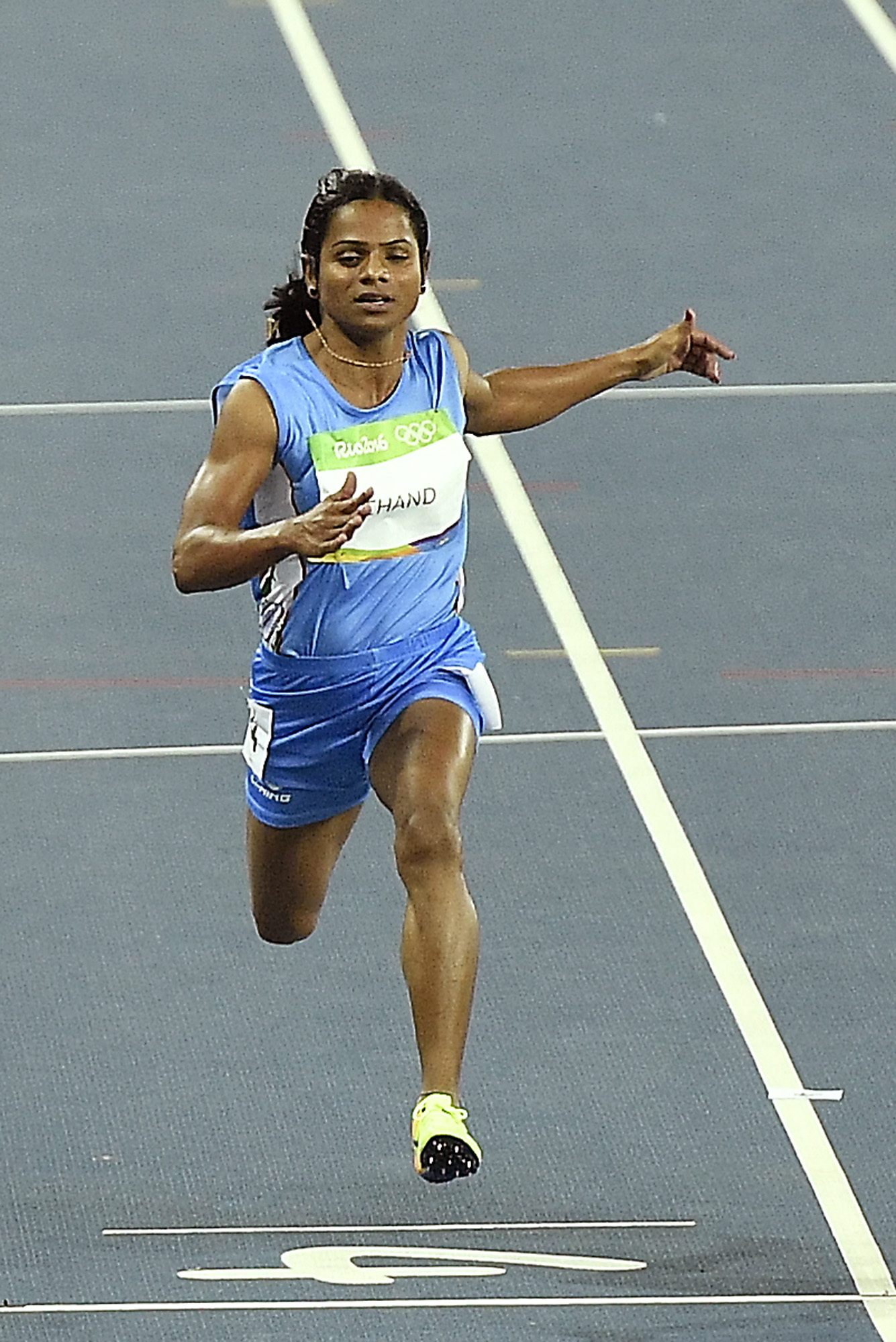 India's Dutee Chand crosses the line in a women's 100-meter first round heat during the athletics competitions of the 2016 Summer Olympics at the Olympic stadium in Rio de Janeiro, Brazil, Friday, Aug. 12, 2016.
