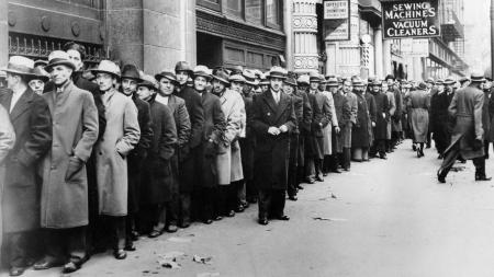 People wait outside the State Labor Bureau for federal relief jobs in New York City in November 1933. (AP Photo)
