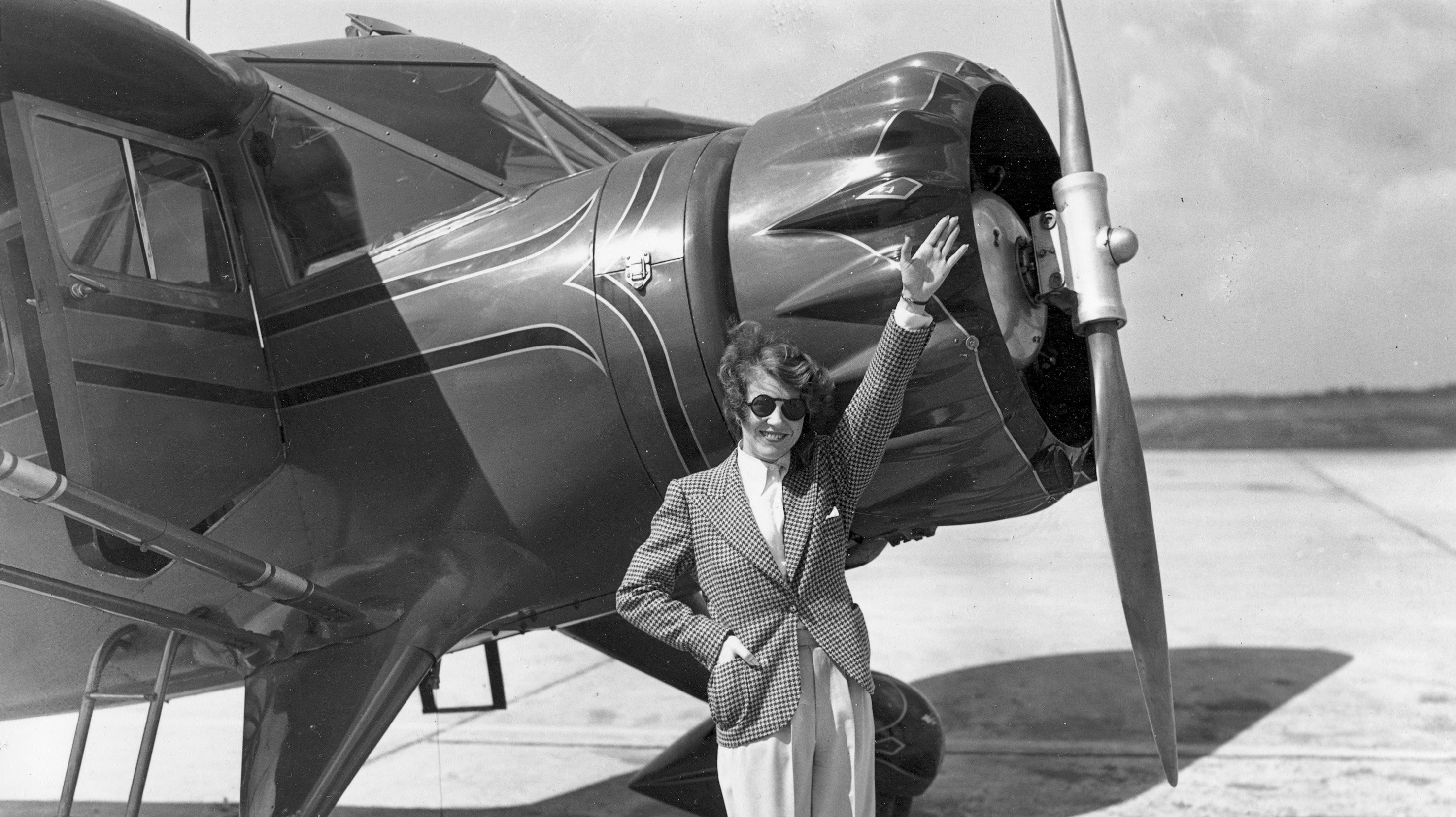 Ruth Chatterton, actress and licensed pilot, waves from beside her airplane before taking off to pace 36 pilots, including 10 women, in the cross-country air derby, named for her, from Cleveland, Ohio, to Los Angeles, Ca., on Aug. 29, 1936. (AP Photo)