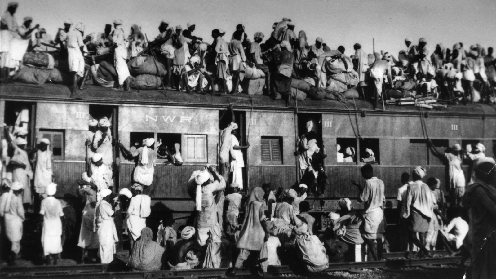 Refugees atop an overcrowded coach of train leaving New Delhi for Pakistan in September 1947.
