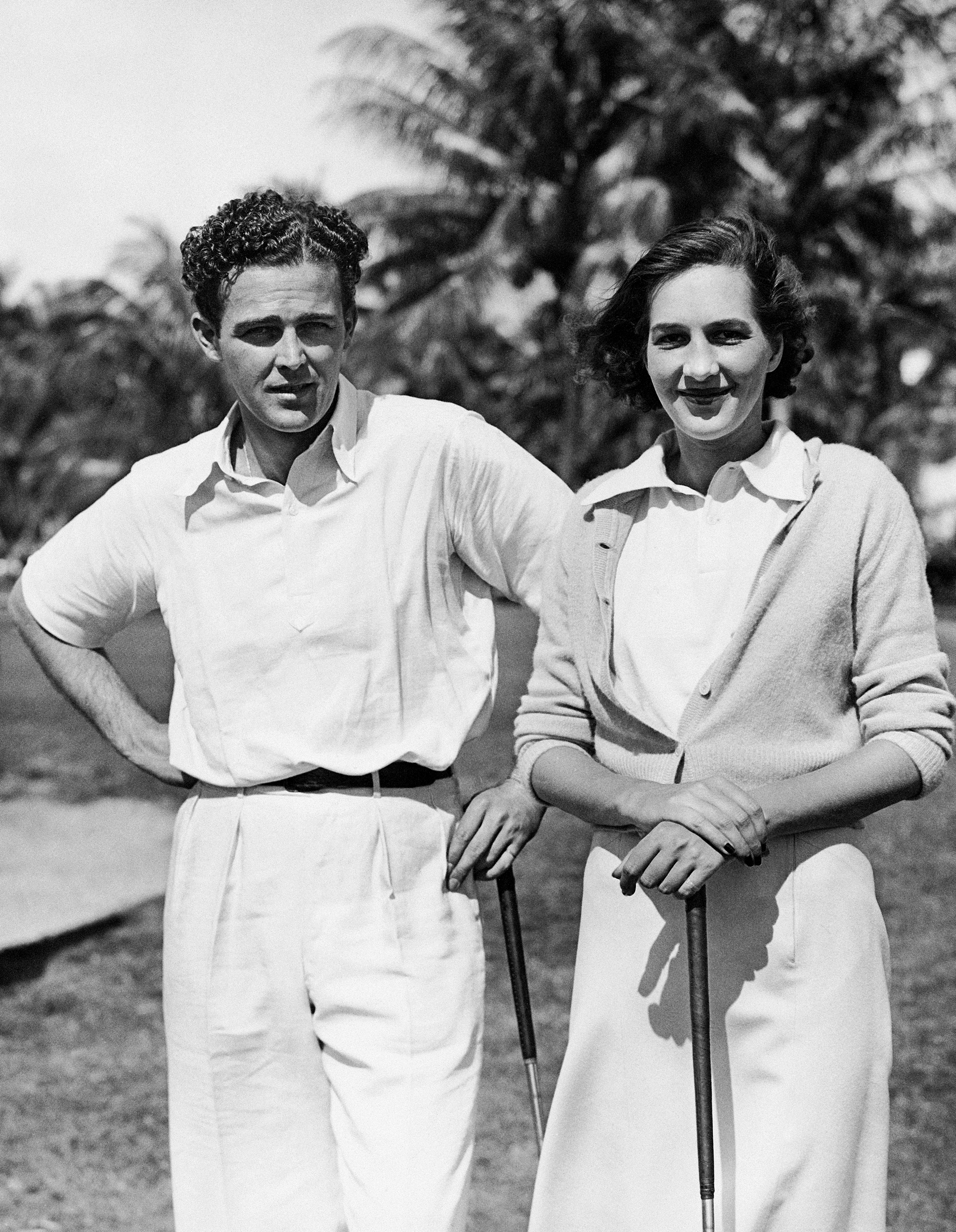 Robert Sweeny Is shown with Miss Grace Amory, step-daughter of Herbert Pulitzer, of New York, on Feb. 14, 1940 at the Everglade Golf Club, Palm Beach, Fla., where they have been paired in the fifth annual mixed two-ball foursome. Watson guest bid $1,125 for the Sweeny Amory team in the auction pool and Bobby exercised his players' option and bought half of the guest's interest. The team turned in the lowest score to qualify on the first day of competition. (AP Photo)