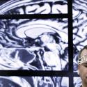 BrainScope employee Doug Oberly wears a brain scanning headset at the NFL owners' meeting in Boca Raton, Fla., Tuesday, March 22, 2016. The headset and mobile app can quickly and easily allow clinicians to determine whether patients have sustained a traumatic brain injury (TBI), the company says. (AP Photo/Luis M. Alvarez)