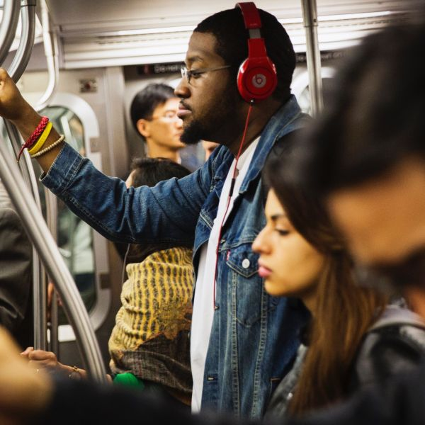 A commuter listens to Beats brand headphones while riding the subway in New York, May 29, 2014. Apple Inc will buy Beats for about $3 billion and bring recording mogul Jimmy Iovine into its ranks, hoping to win points with the music industry and help it catch up in fast-growing music streaming. As expected, Beats co-founders Iovine and rapper Dr. Dre will join Apple as part of the acquisition of the music streaming and audio equipment company. They should prove key in forging relationships with an industry that historically viewed Apple with suspicion but in recent years has pressed the iPhone maker to do more on subscription services, a market expected to eclipse song downloads in the long run.  REUTERS/Lucas Jackson (UNITED STATES - Tags: BUSINESS TRANSPORT) - RTR3RDV9