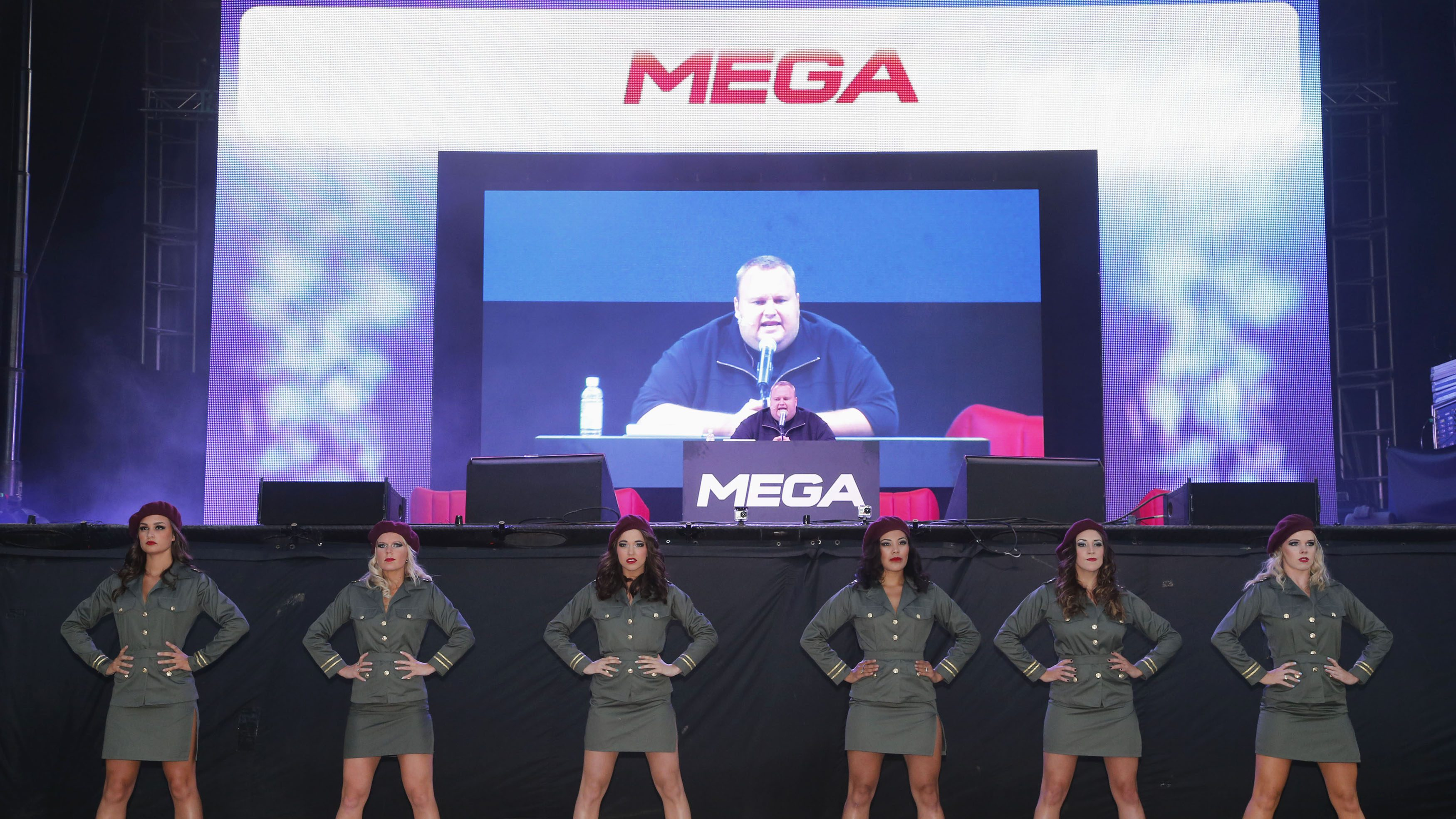 "Megaupload founder Kim Dotcom (C) launches his new file sharing site ""Mega"" in Auckland January 20, 2013. Dotcom, who is fighting extradition to face U.S. charges of internet piracy, has launched a new cloud storage service called ""Mega"" at a function at Dotcom Mansion in Coatsville, Auckland."