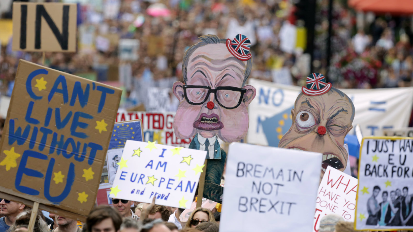 People hold banners during a 'March for Europe' demonstration against Britain's decision to leave the European Union, in central London, Britain July 2, 2016. Britain voted to leave the European Union in the EU Brexit referendum.