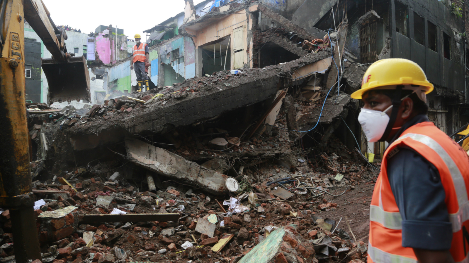 Rescue workers search among the debris at the site of building collapse in Bhiwandi, outskirts in Mumbai, India, Sunday, July 31, 2016 .