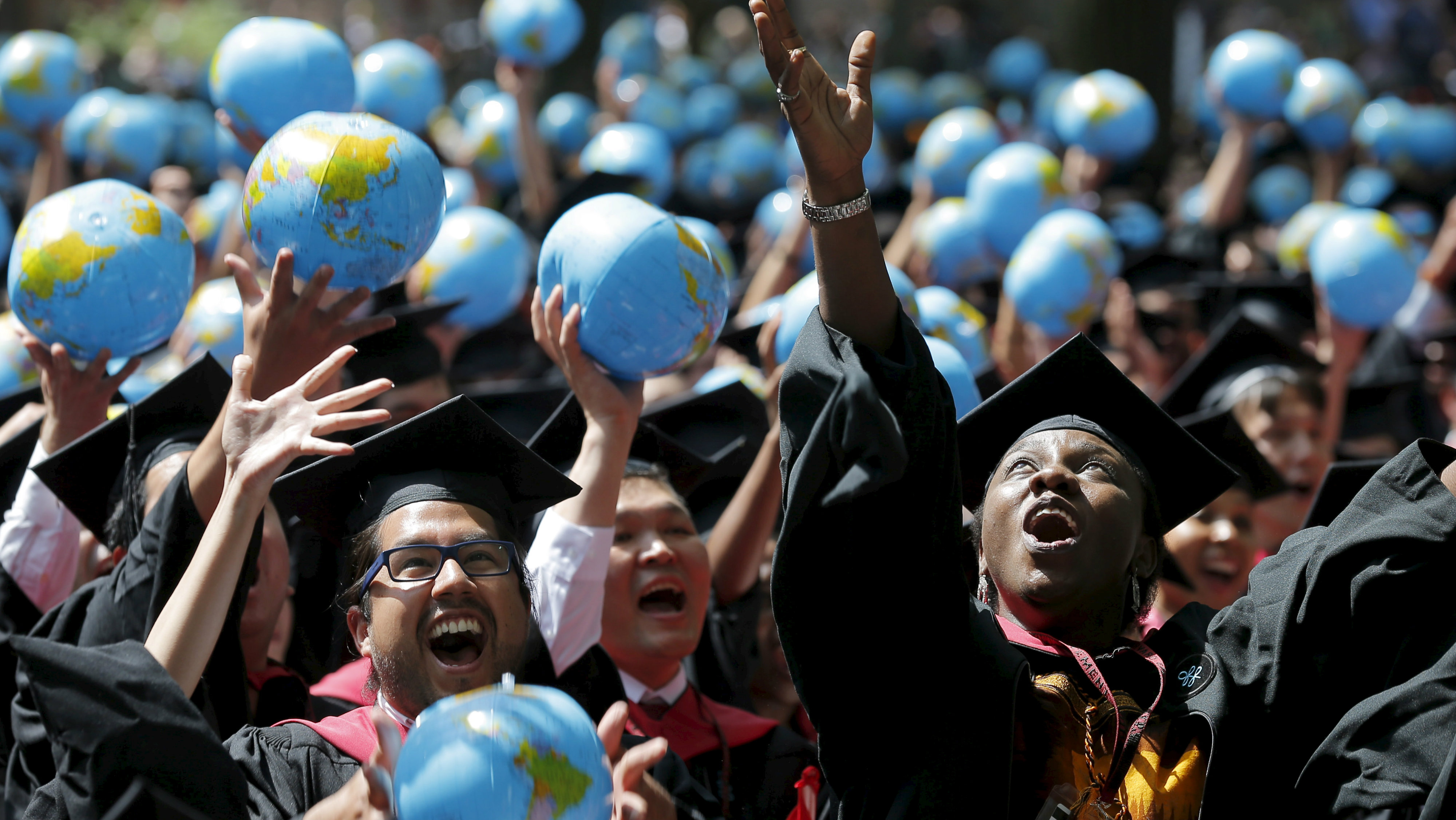 A commencement ceremony with globe balloons.
