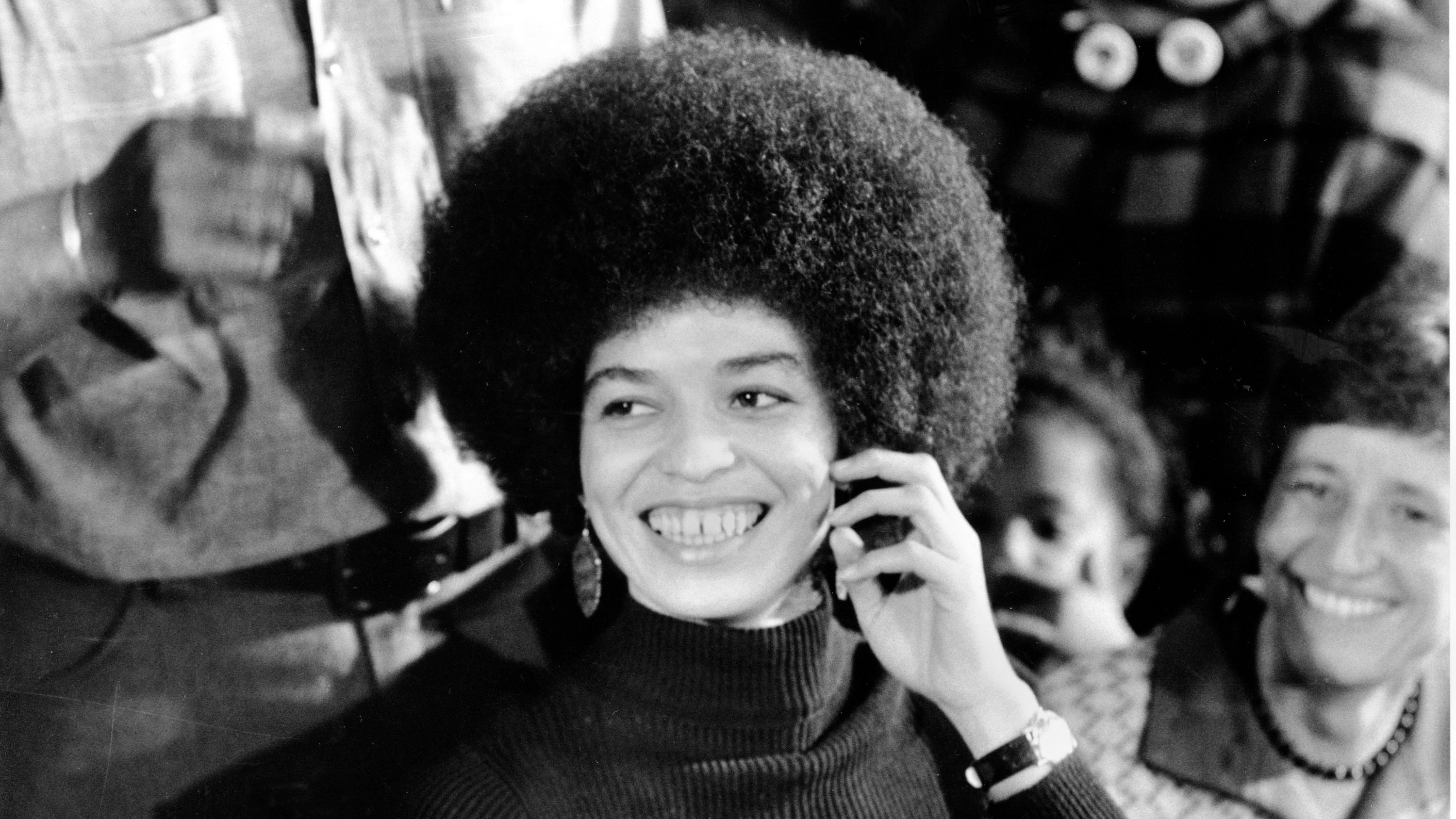 Angela Davis, the self-acclaimed communist and revolutionary, smiles at a news conference in her San Jose headquarters on Feb. 25, 1972, a day after she is released on $102,500 bail. Davis, who is to begin trial on murder, conspiracy and kidnap charges, has been in jail for 16 months after her arrest in connection with the escape attempt at Marin County Courthouse shoot-out in August, 1970.