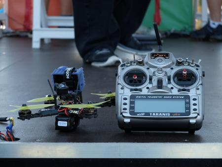 A standard FPV drone and radio controller found at the Drone Nationals.