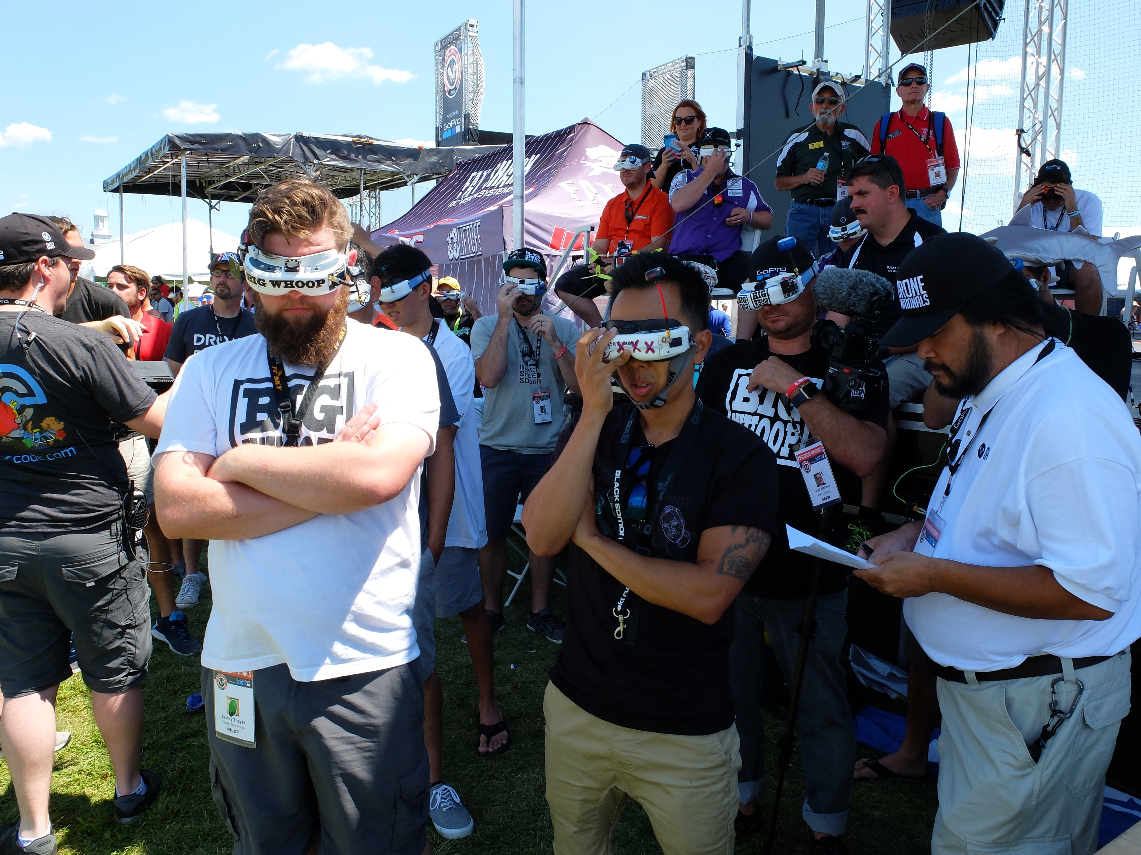 Pilots watching through FPV goggles.